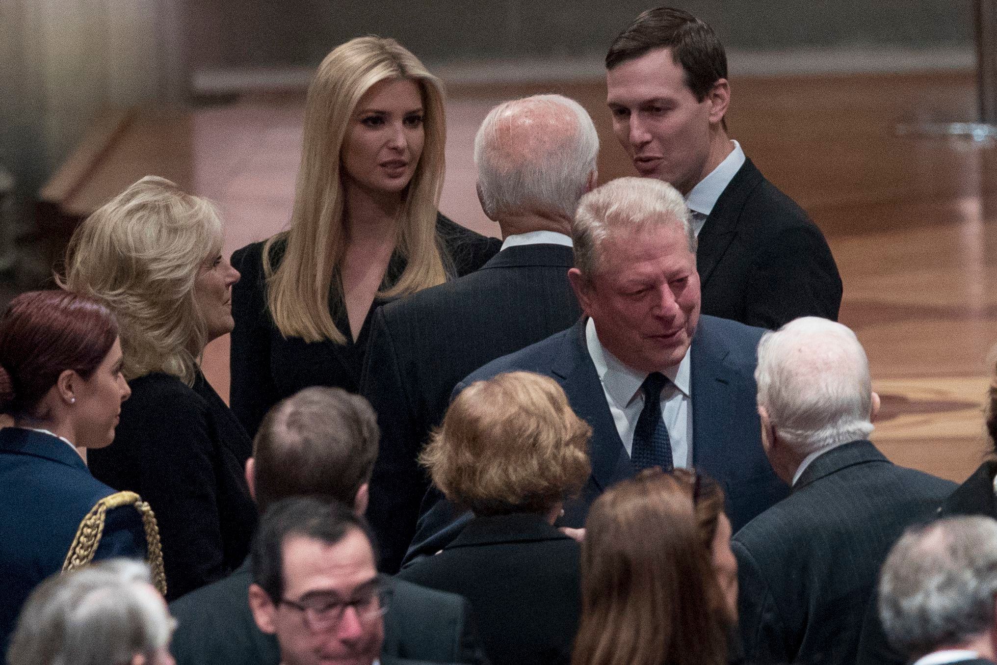 Former Vice President Joe Biden, and his wife Jill Biden, speak with Ivanka Trump, the daughter of President Donald Trump, and her husband, President Donald Trump's White House Senior Adviser Jared Kushner, as former Vice President Al Gore, speak to former President Jimmy Carter, and former first lady Rosalynn Carter, before a State Funeral for former President George H.W. Bush at the National Cathedral, in Washington, DC on Dec. 5, 2018.