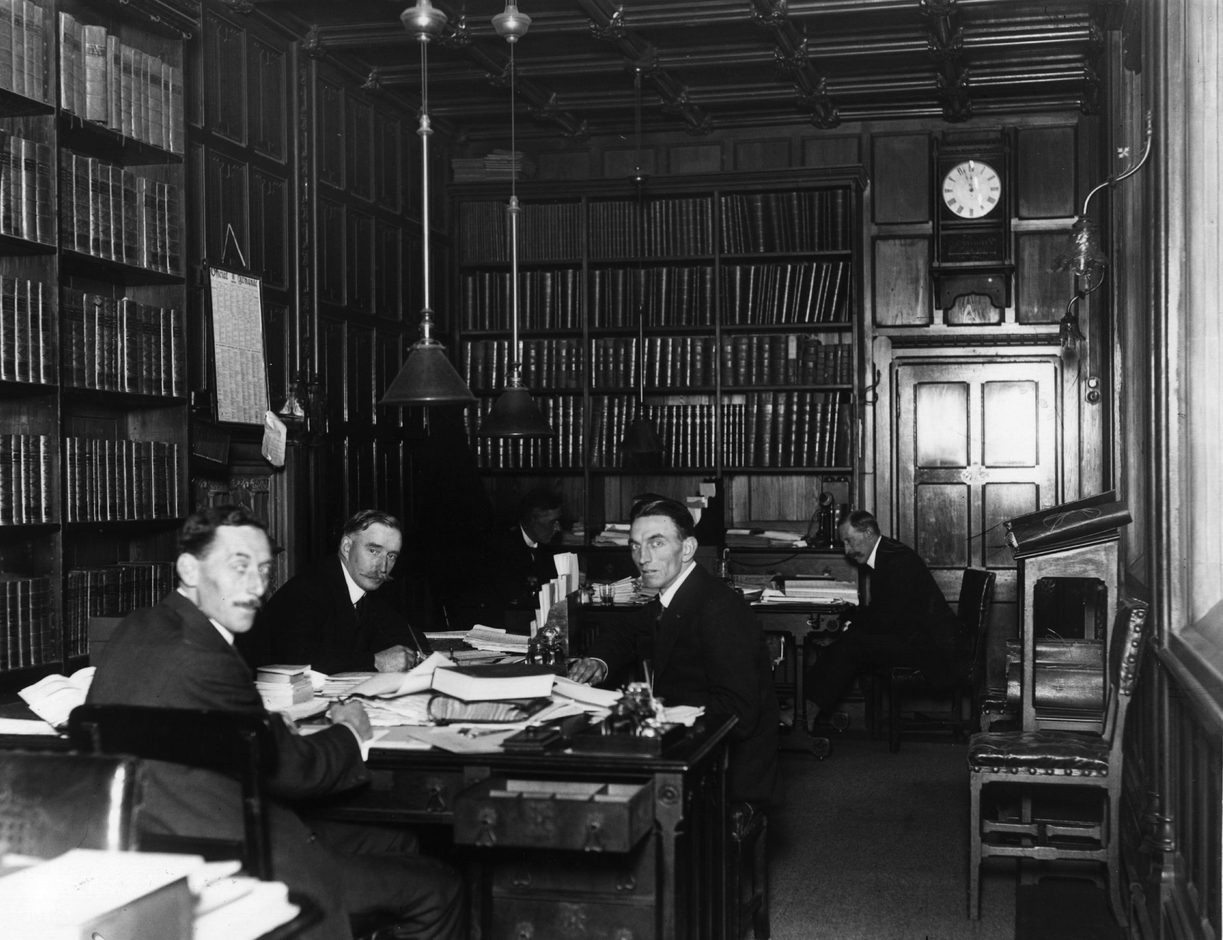 November 1919:  Men at work in the House of Commons library, London.