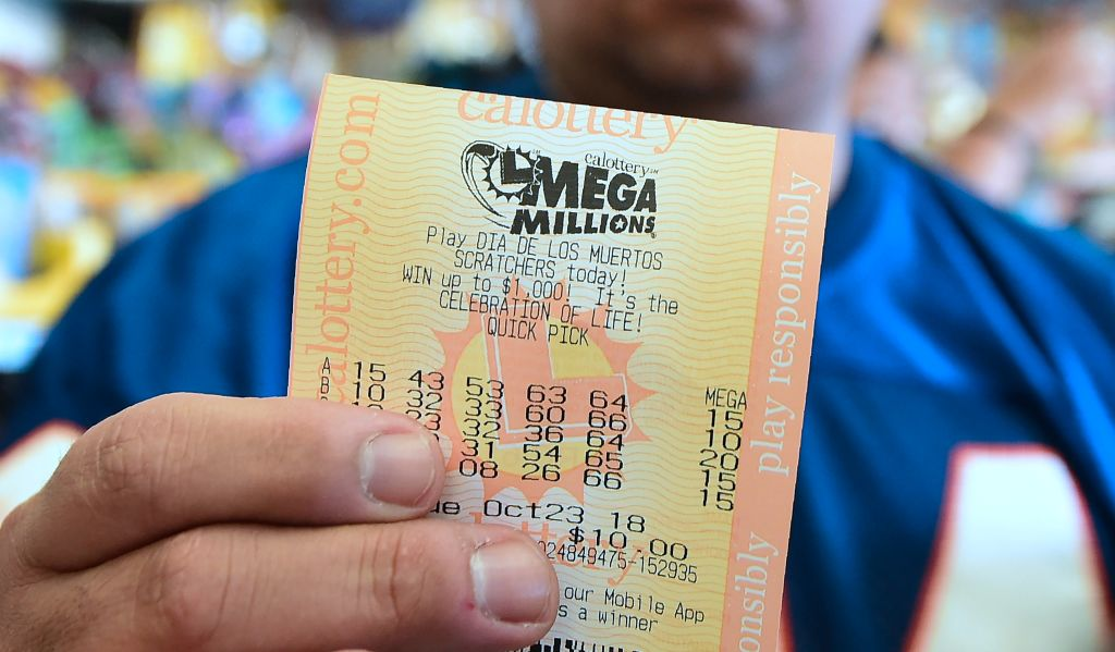 A man shows his just purchased lottery tickets in Hawthorne, California on October 23, 2018