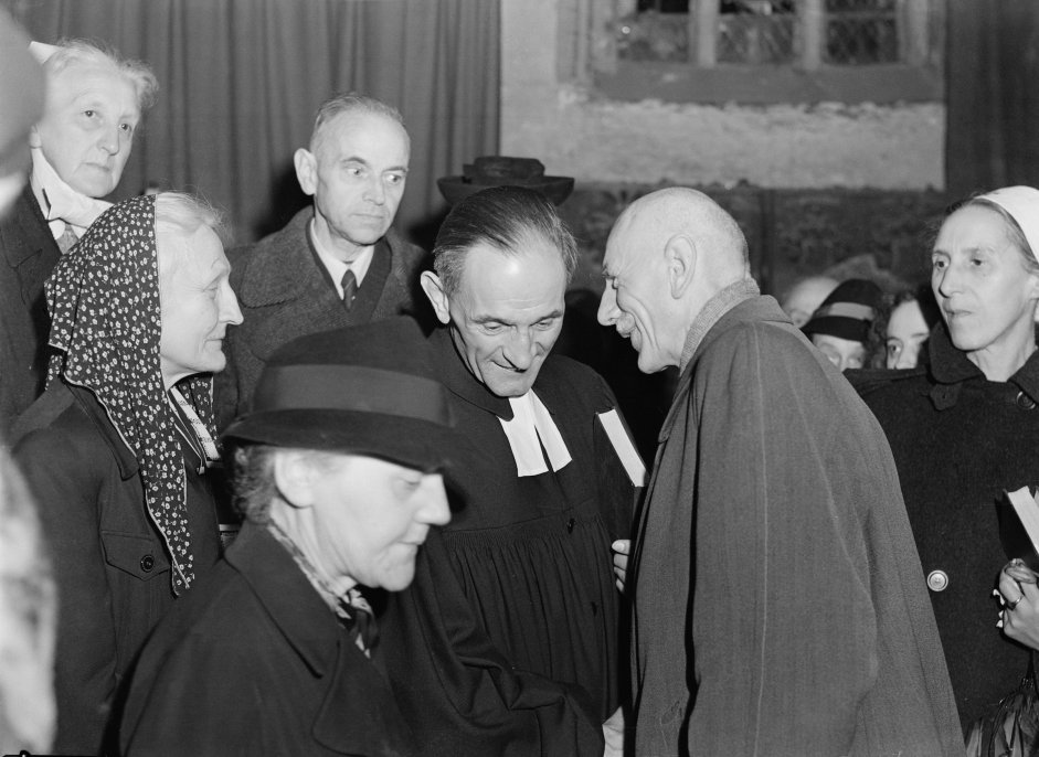 German anti-Nazi theologian and Lutheran pastor, Martin Niemoller (center) with members of the congregation at St. Anne's church in Dahlem, Berlin, after he held his first service since his release from imprisonment, following the allied occupation of Germany, Oct. 28, 1945. Niemoller had been imprisoned by the Nazi regime since 1938.