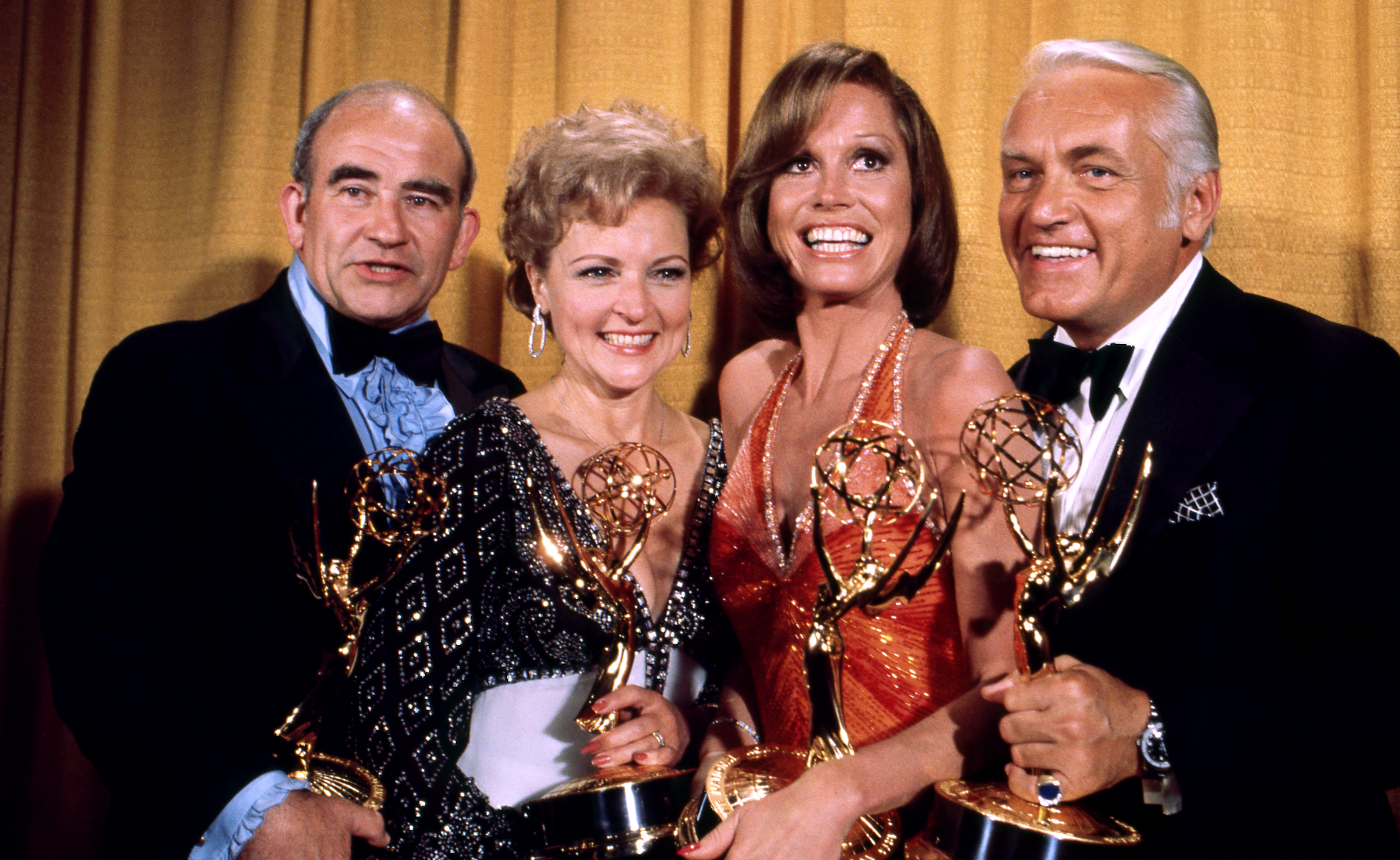 Edward Asner, Betty White, Mary Tyler Moore and Ted Knight holding their Emmy Awards in the press room at the 28th Annual Primetime Emmy Awards on May 17, 1976 at The Shubert Theatre in Los Angeles, California.
