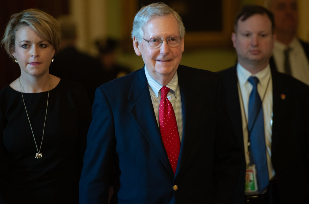 US Senate Majority Leader Mitch McConnell (C), Republican of Kentucky, walks to his office at the US Capitol in Washington, DC, December 21, 2018. - A US government shutdown appeared more and more likely to become a reality just before Christmas, with President Donald Trump threatening a  very long  federal work stoppage unless Democrats agree to his border wall demands. (Photo by SAUL LOEB / AFP)        (Photo credit should read SAUL LOEB/AFP/Getty Images)