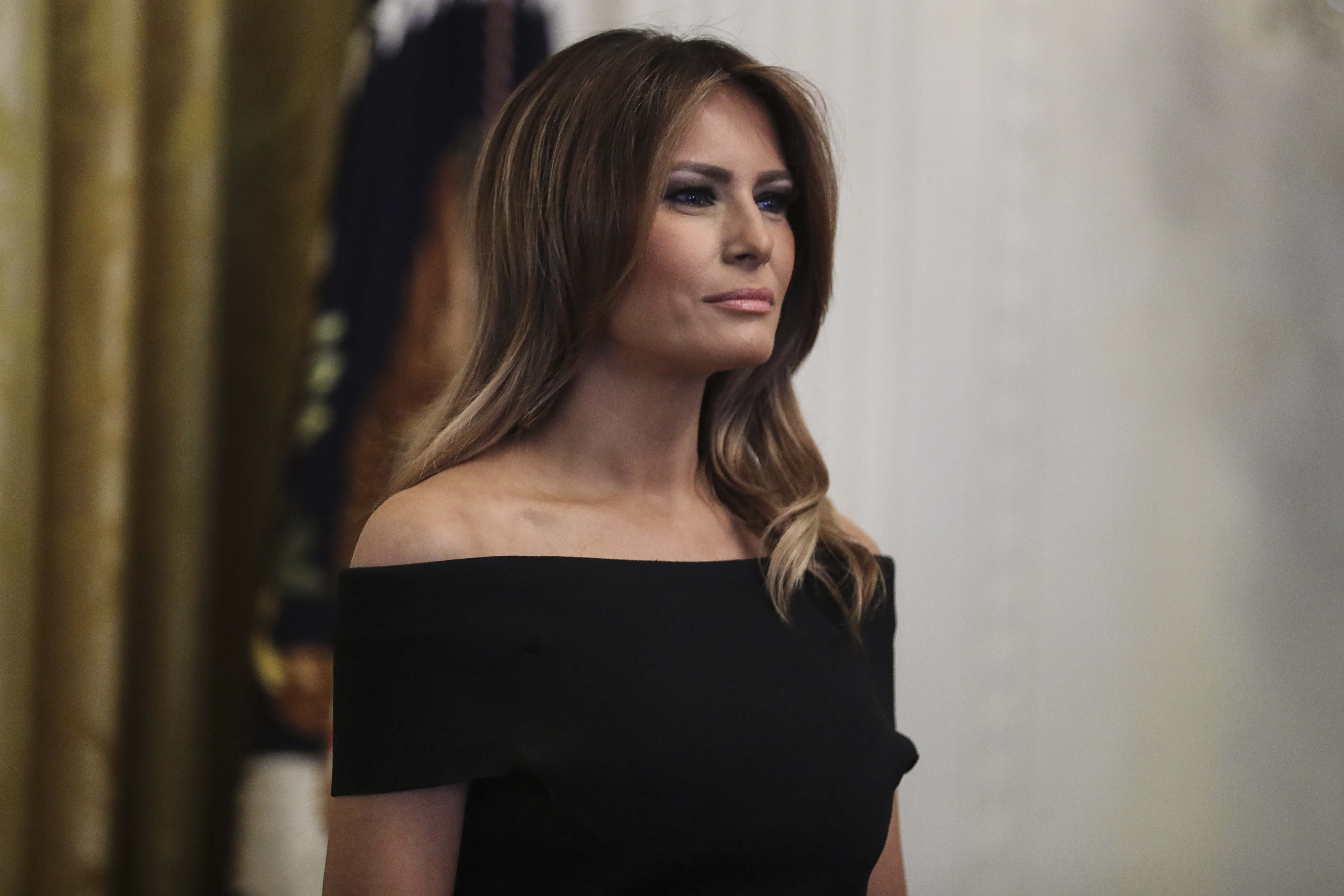 First lady Melania Trump listens as President Trump speaks during a Hanukkah reception in the East Room of the White House on December 6, 2018 in Washington, DC.