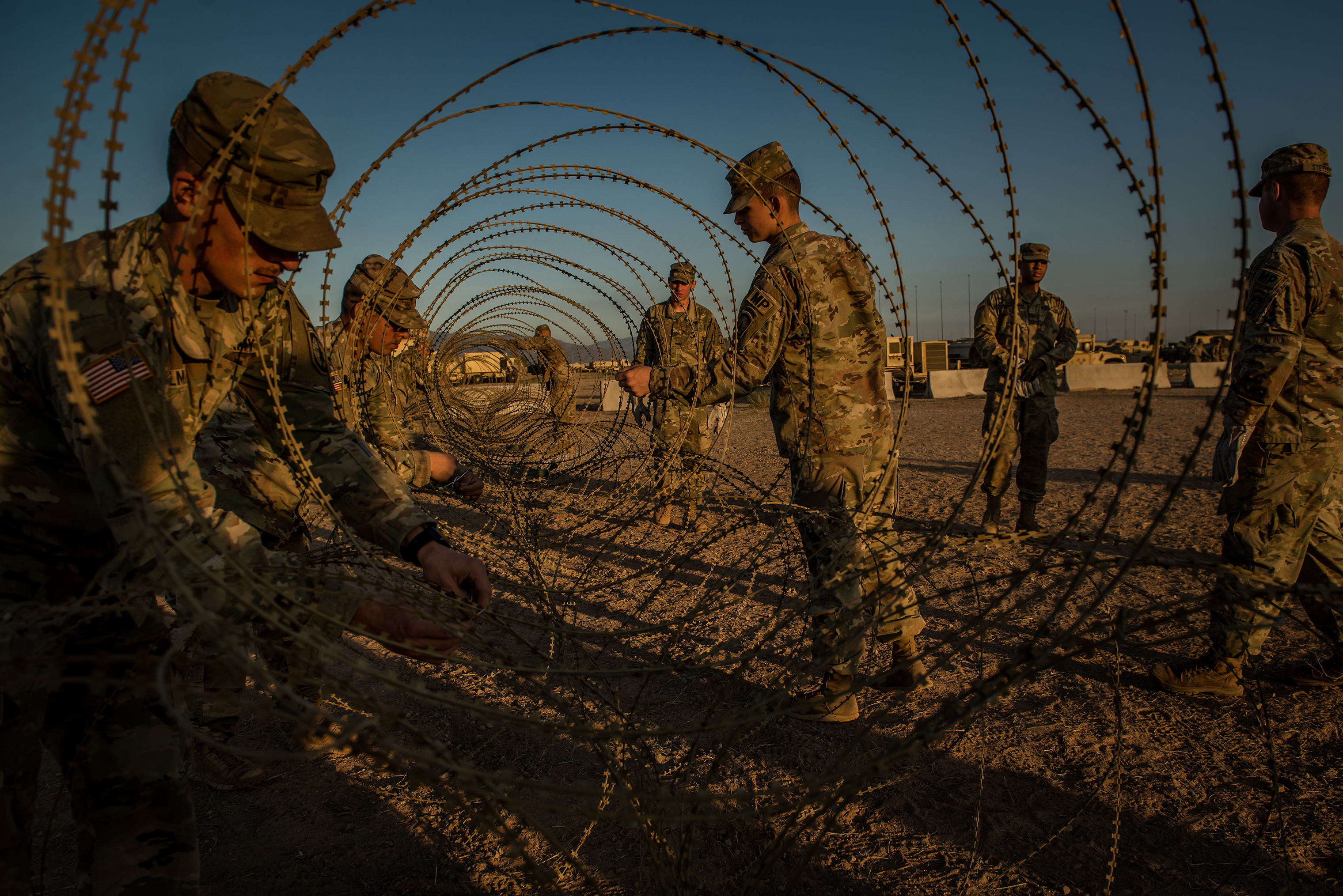 Razor wire is used to help protect a shipping container holding guns and sensitive material. After President Trump's orders in October, some 7,000 active-duty troops began to flood border communities from San Diego to Brownsville, Texas, a deployment that equals the troops fighting ISIS in Iraq and Syria.