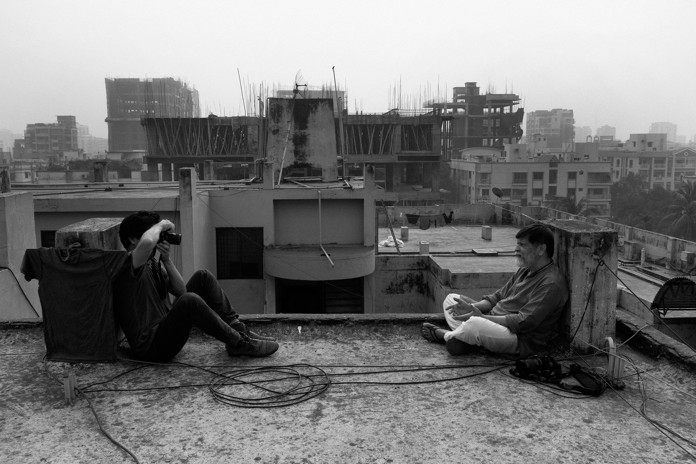 Moises Saman photographing Shahidul Alam on Dec.5 on his Dhaka, Bangladesh, rooftop
