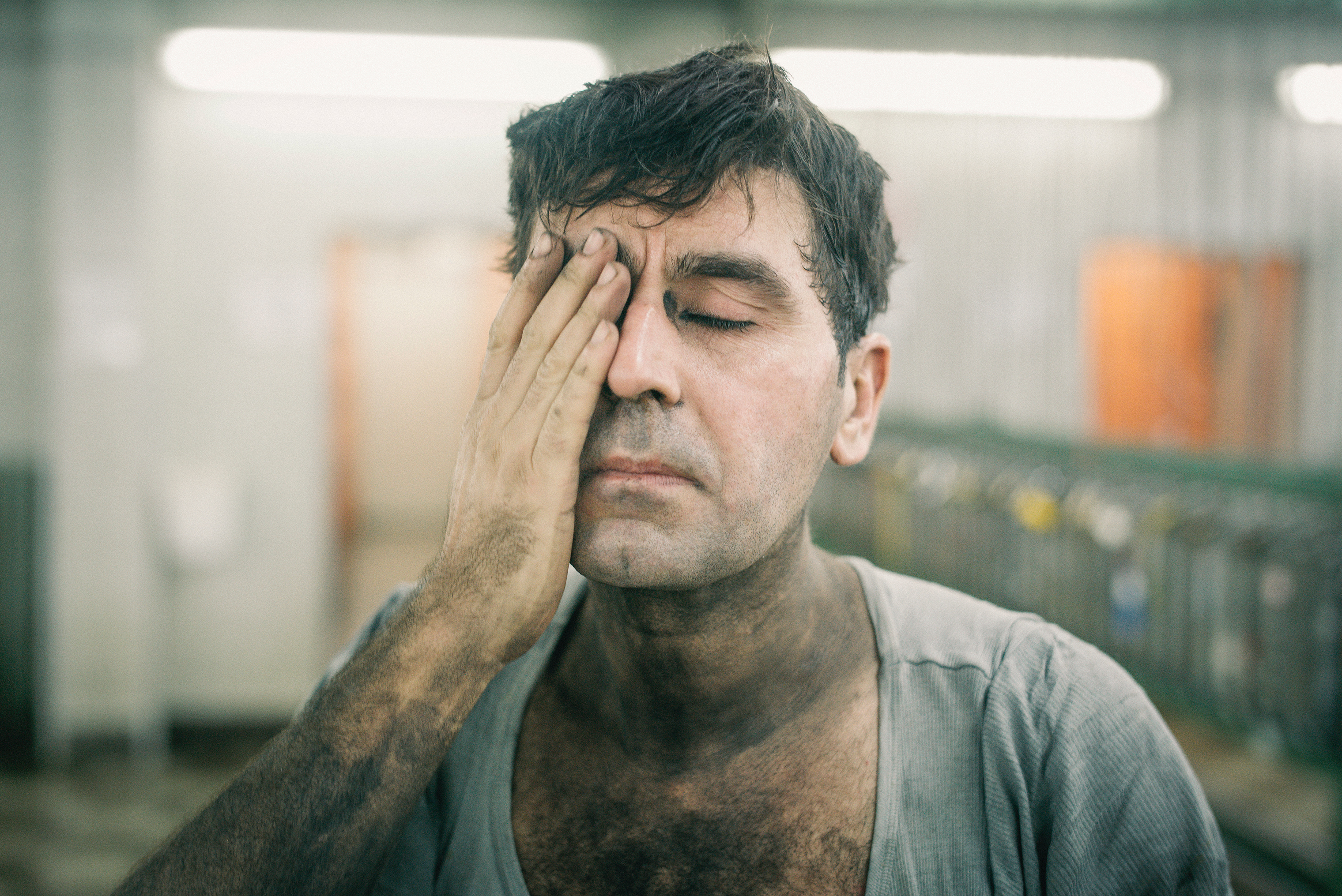 Cin, a Turkish miner, washes coal dust from his face after a night shift in December 2017.