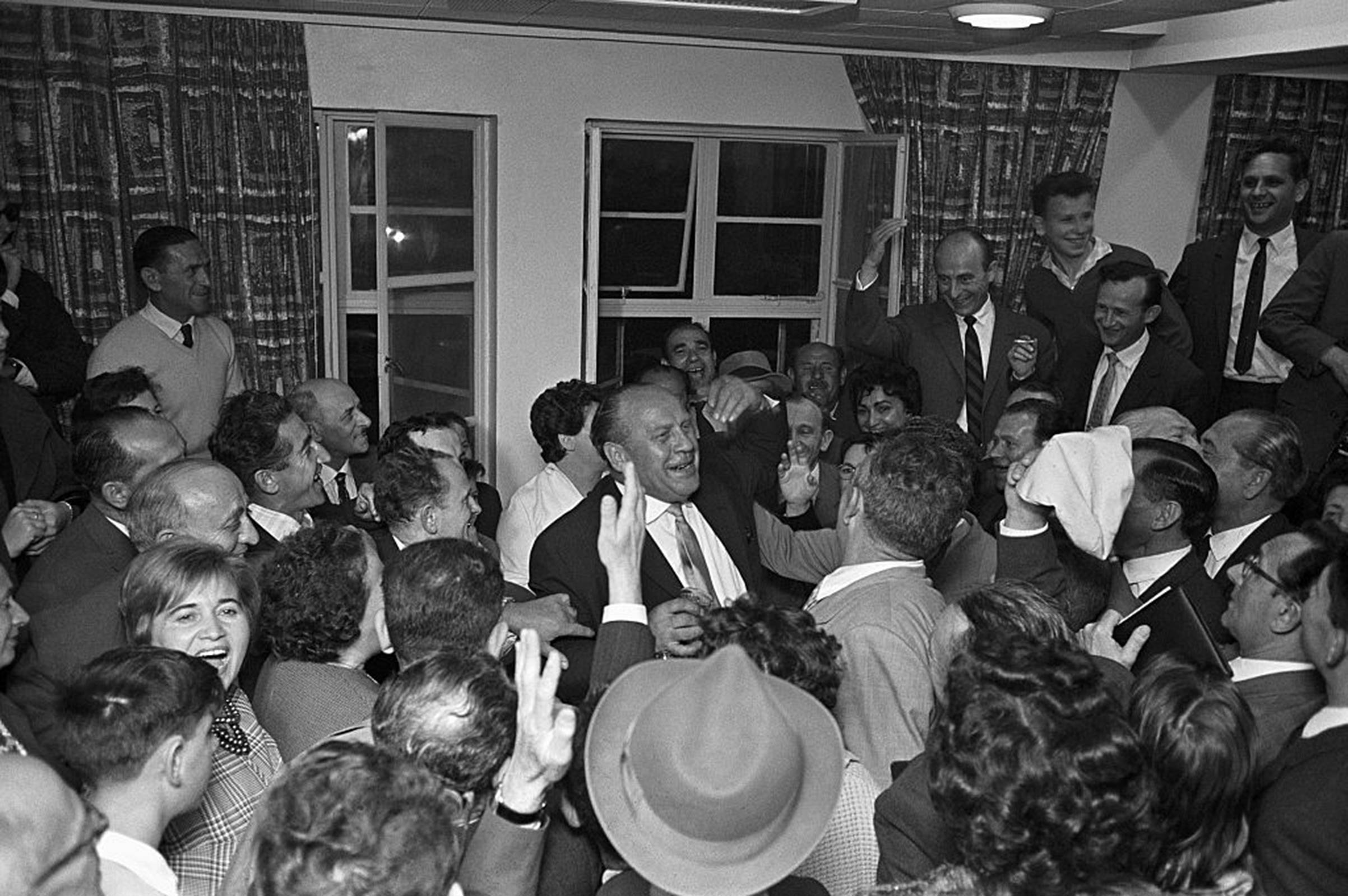 Oskar Schindler (center) receives a hero's welcome from some of the Holocaust survivors he saved during a May 1962 visit to Tel Aviv, Israel.