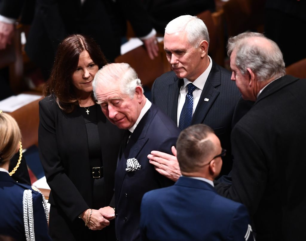 Britain's Prince Charles is greeted by Karen Pence and her husband, U.S. Vice President Mike Pence, as they arrive for the funeral service for former US President George H. W. Bush at the National Cathedral in Washington, DC on December 5, 2018.