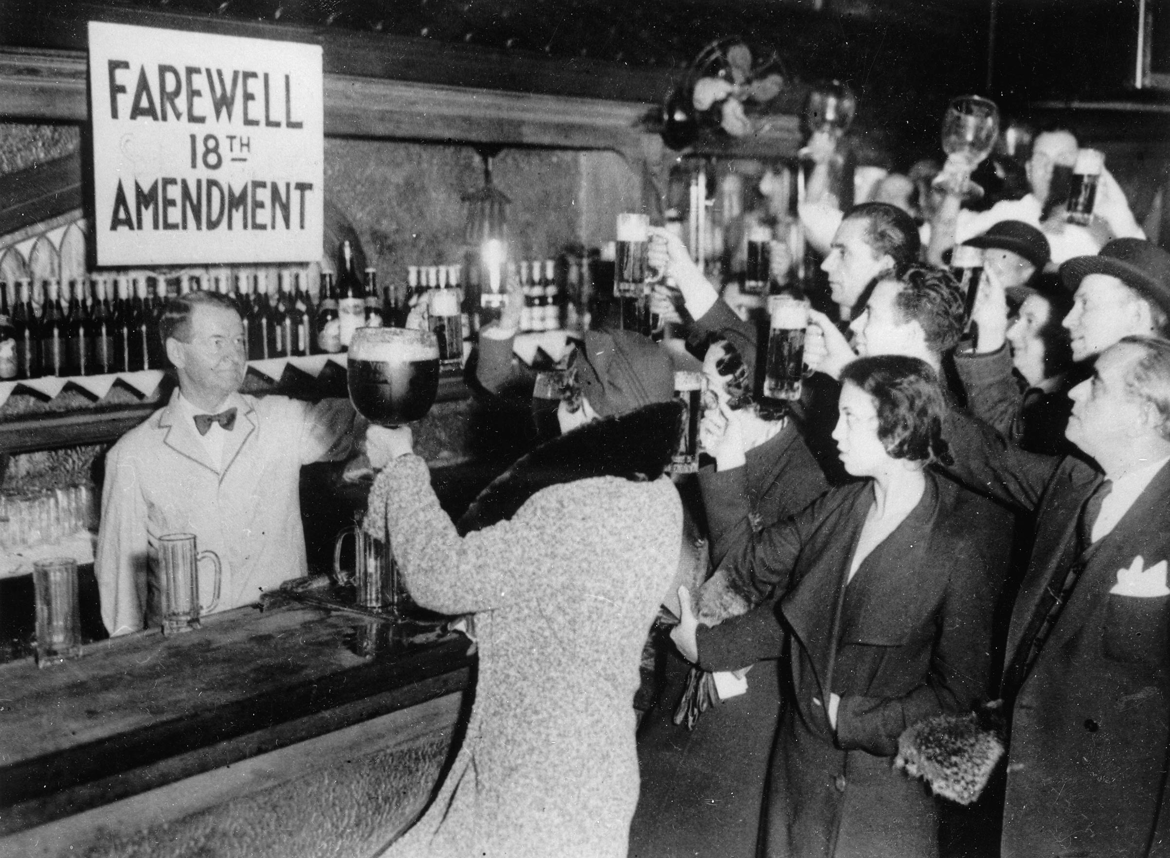 New Yorkers bid farewell to the 18th Amendment that legalized Prohibition and which was repealed by the 21st Amendment on Dec. 5, 1933.