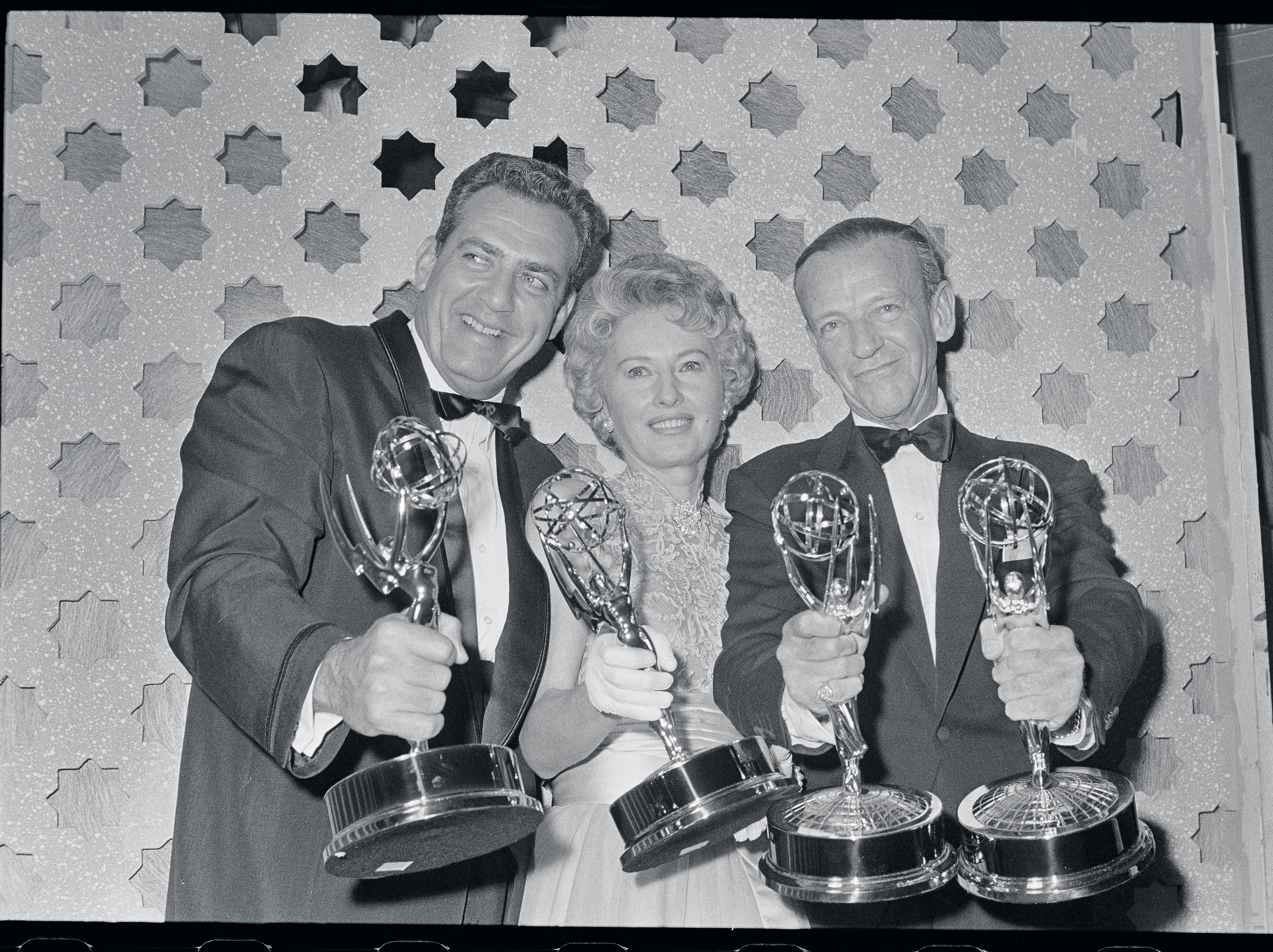 The three top Emmy winners pose proudly with their trophies. (Left and right) Raymond Burr, Barbara Stanwyck, and Fred Astaire were honored by the Academy of Television Arts and Sciences for outstanding television shows.