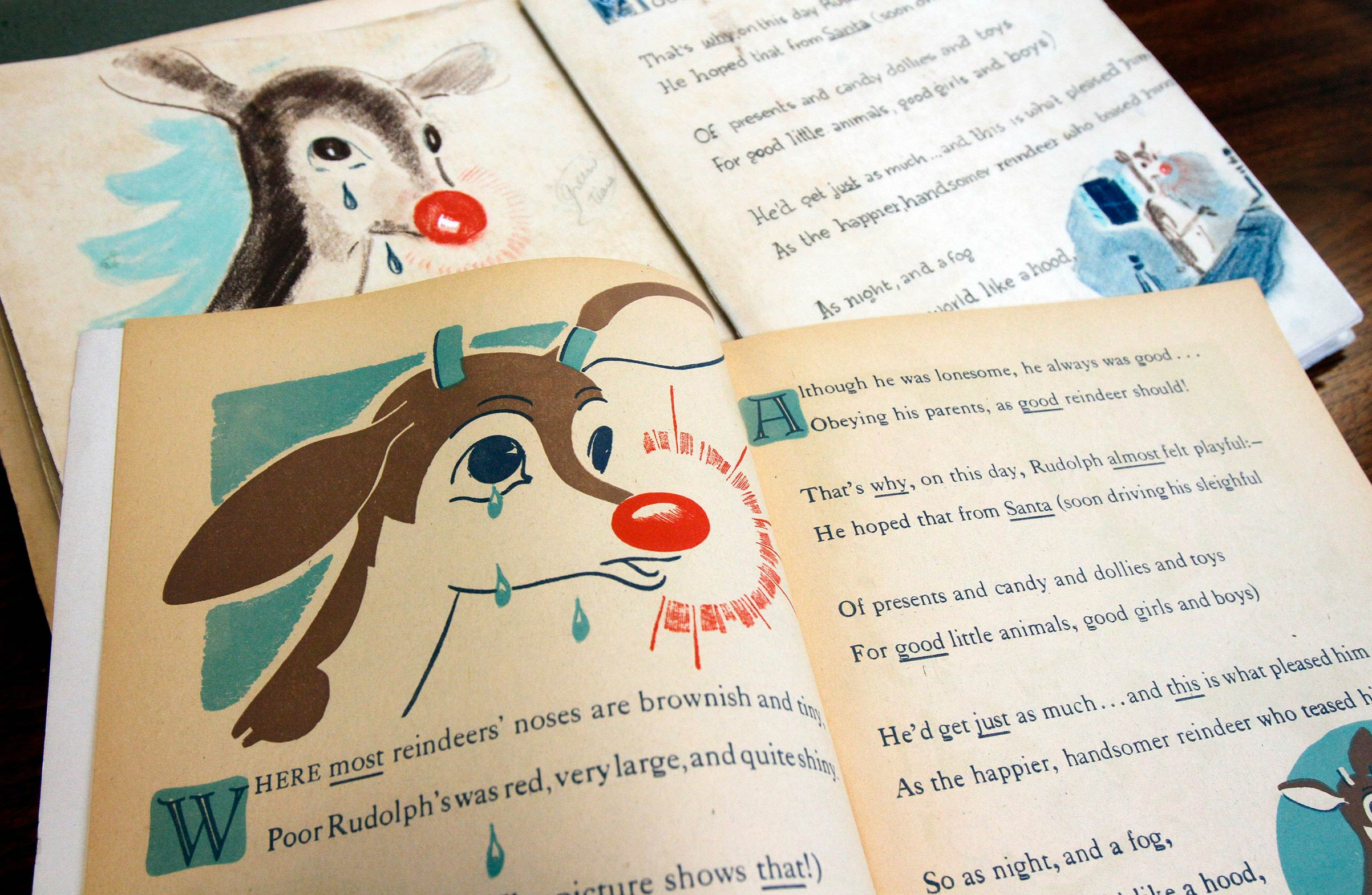 A first edition of  Rudolph, the Red-Nosed Reindeer , bottom, and an original layout, top, on Dec. 20, 2011, at Dartmouth College in the Rauner Special Collections Library in Hanover, N.H.