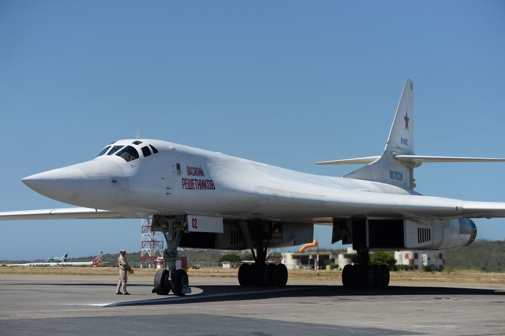 A Russian Tupolev Tu-160 strategic long-range heavy supersonic bomber aircraft is pictured upon landing at Maiquetia International Airport, just north of Caracas, Venezuela, on December 10, 2018.
