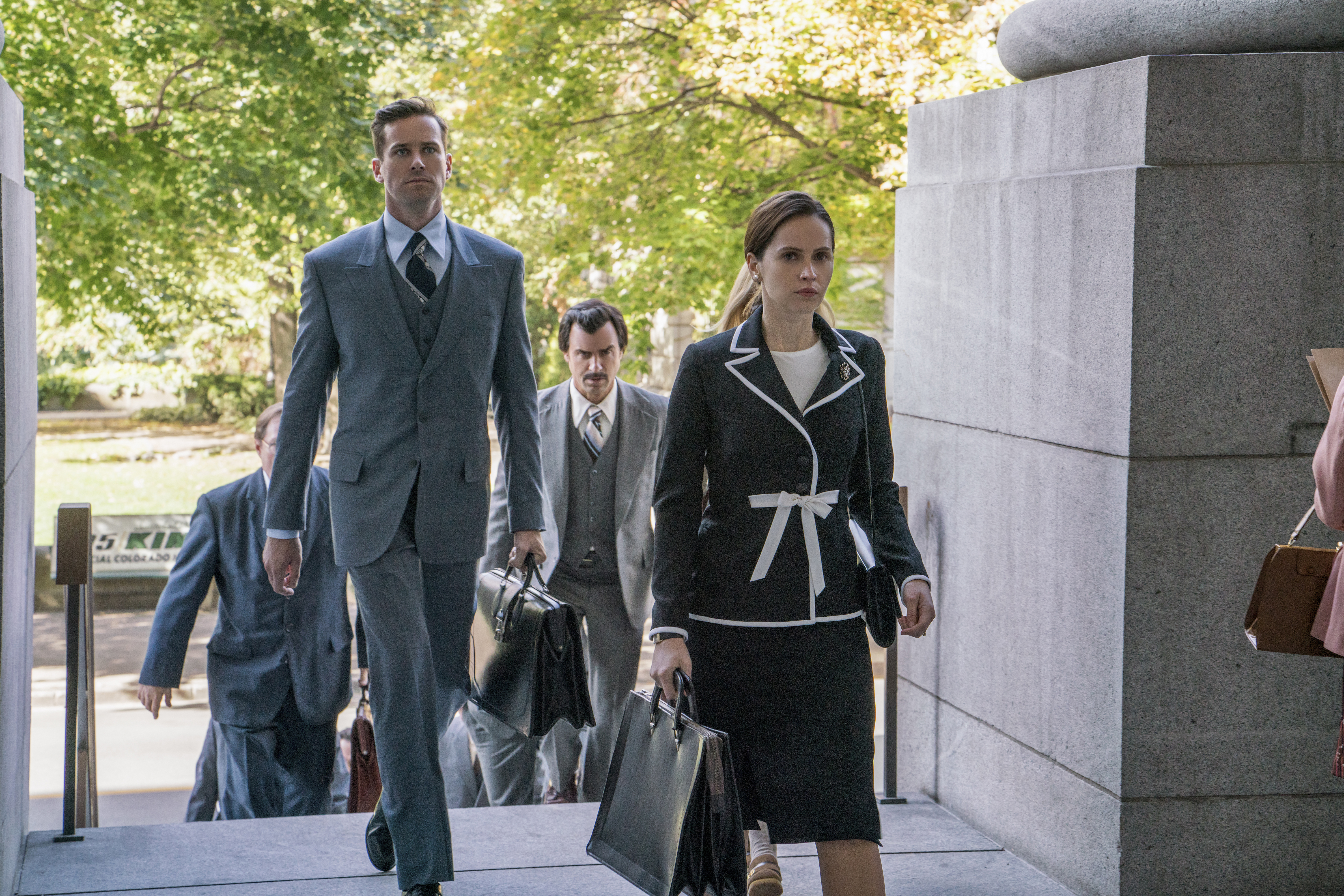(l to r.) Armie Hammer as Marty Ginsburg, Justin Theroux as Melvin Wulf, and Felicity Jones as Ruth Bader Ginsburg.