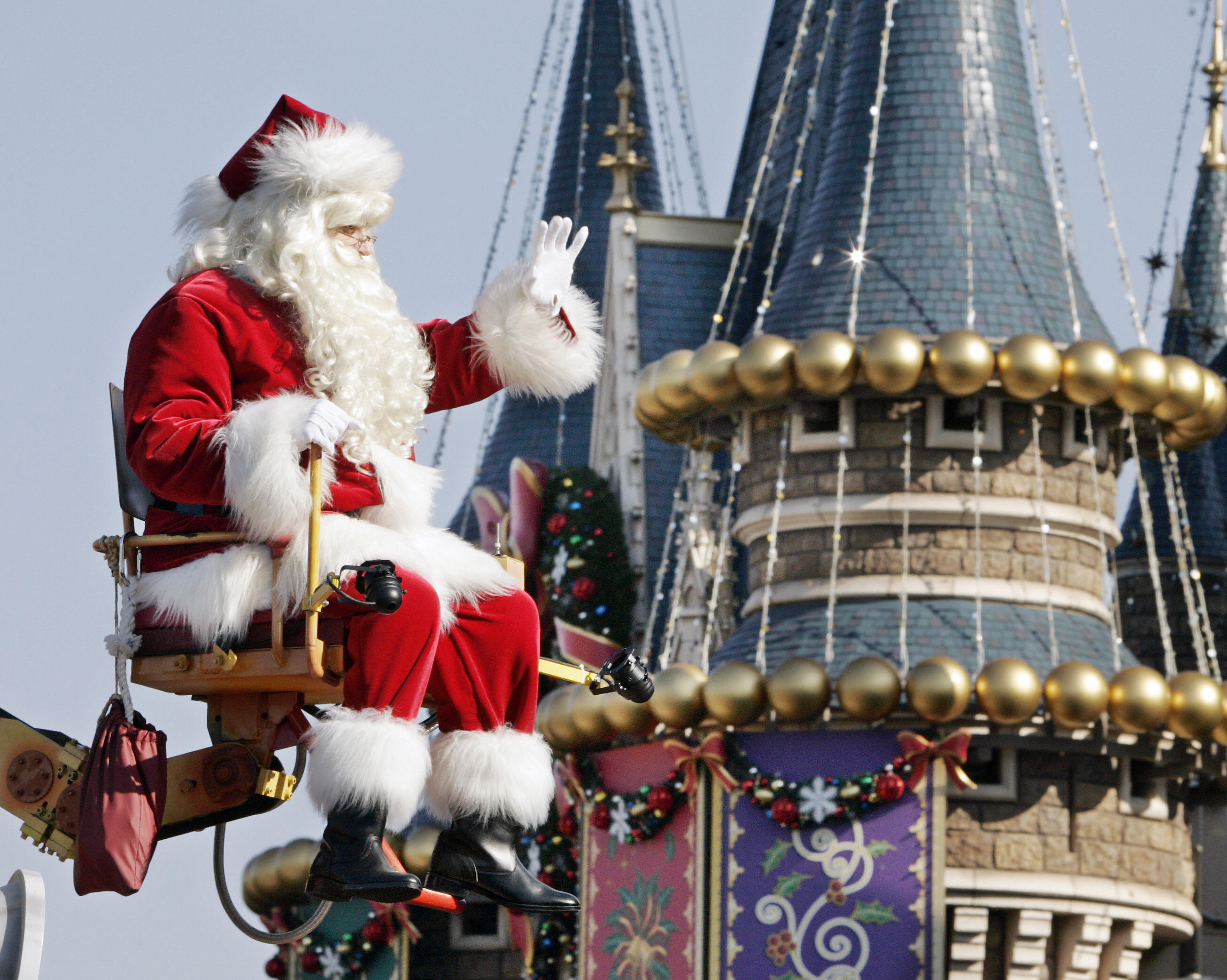 Santa Claus waves in front of the castle during a parade at  Tokyo Disneyland at Urayasu city in Chiba prefecture, 21 December 2007.