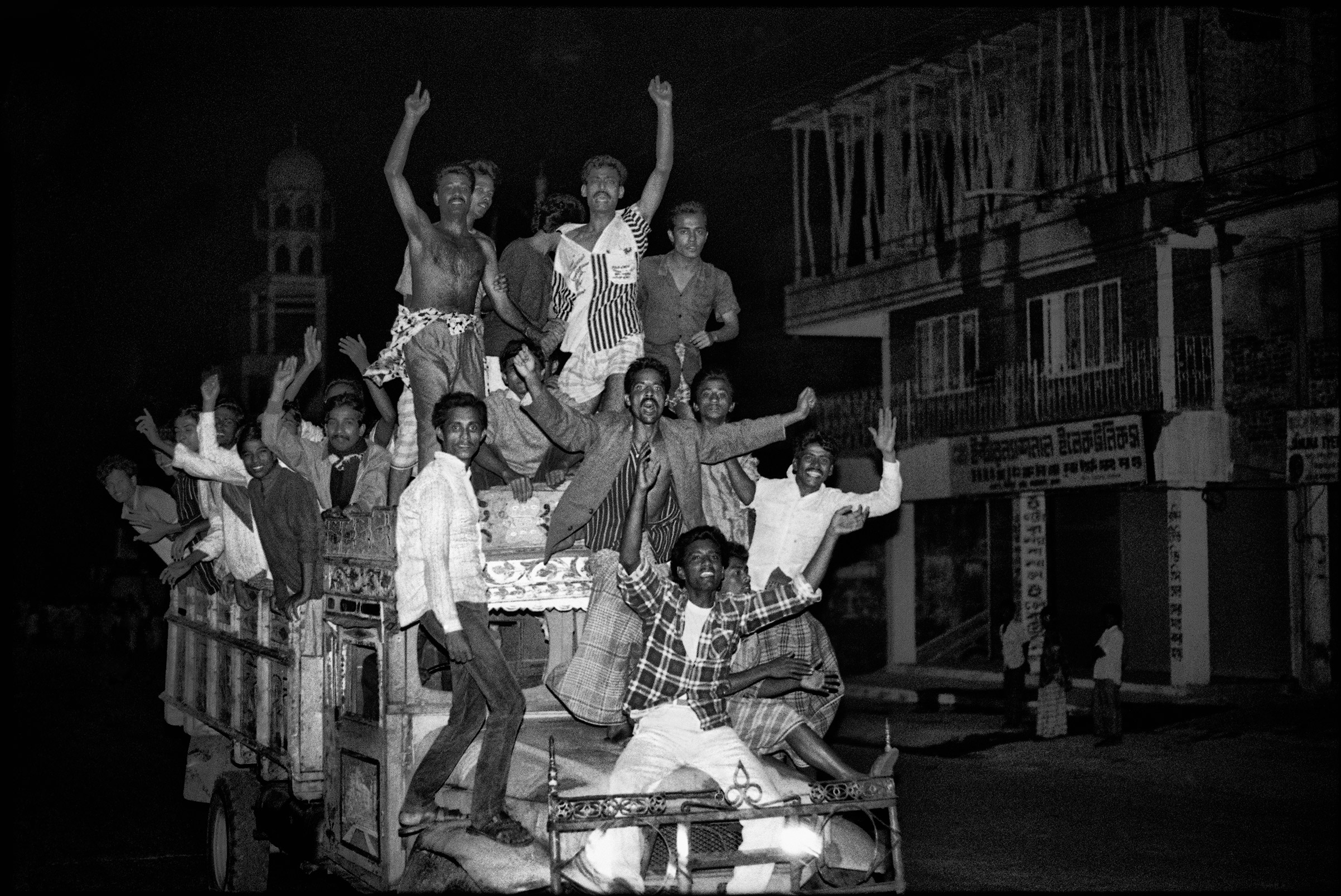 People rejoice after the fall of General Hussain Muhammad Ershad, in Dhaka, Bangladesh, December 4, 1990.