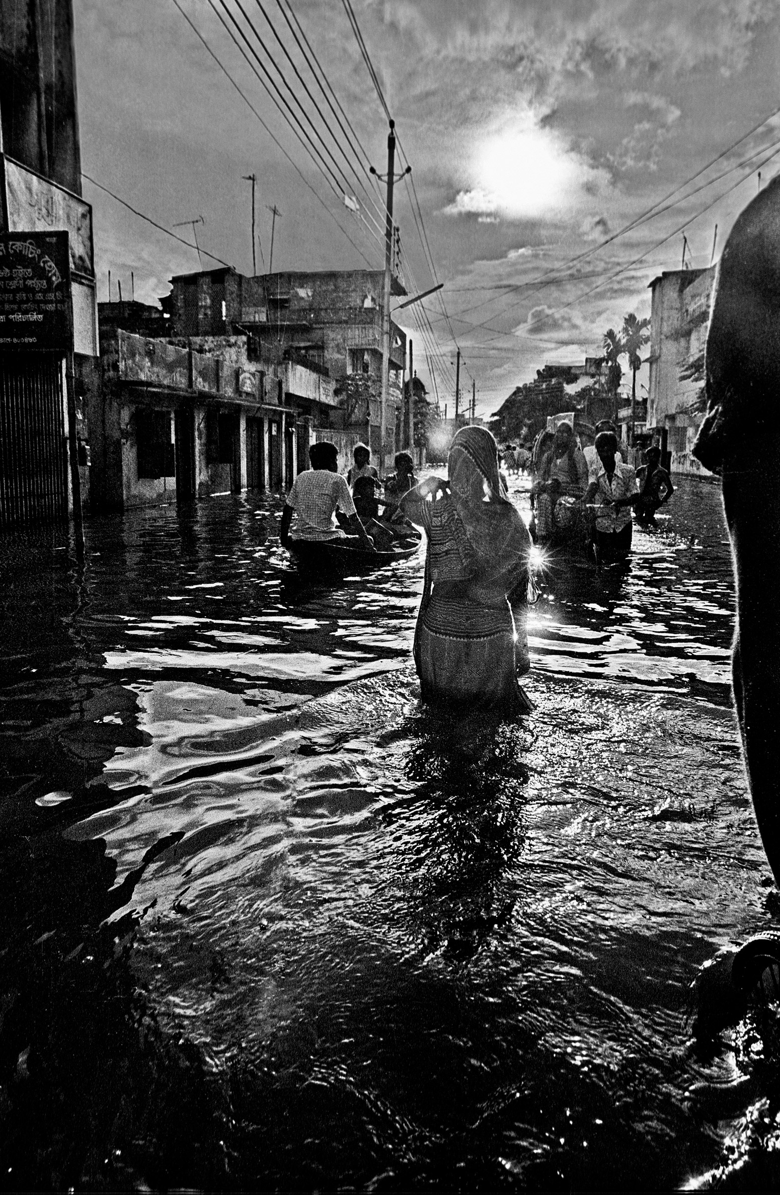 Woman wading in flood waters, Kamalapur, Dhaka, Bangladesh. 1988.