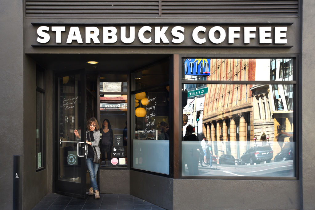 A customer leaves a Starbucks Coffee shop in San Francisco, California.
