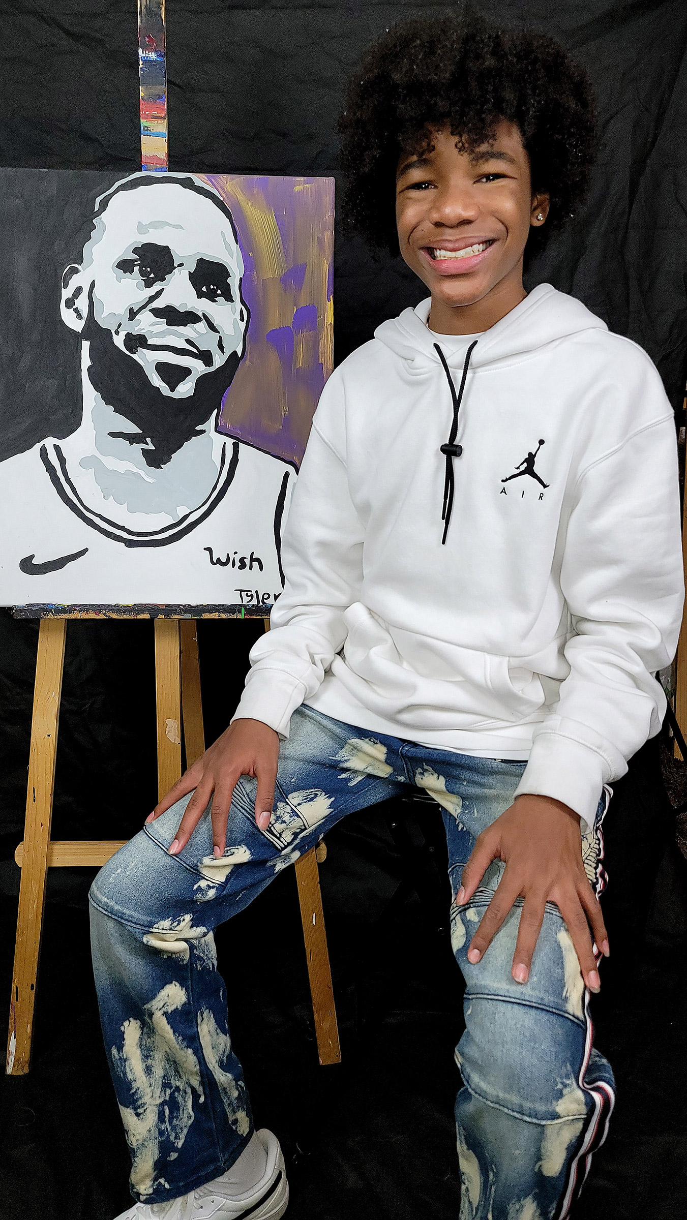 Tyler Gordon, 14, with his painting of Athlete of the Year LeBron James