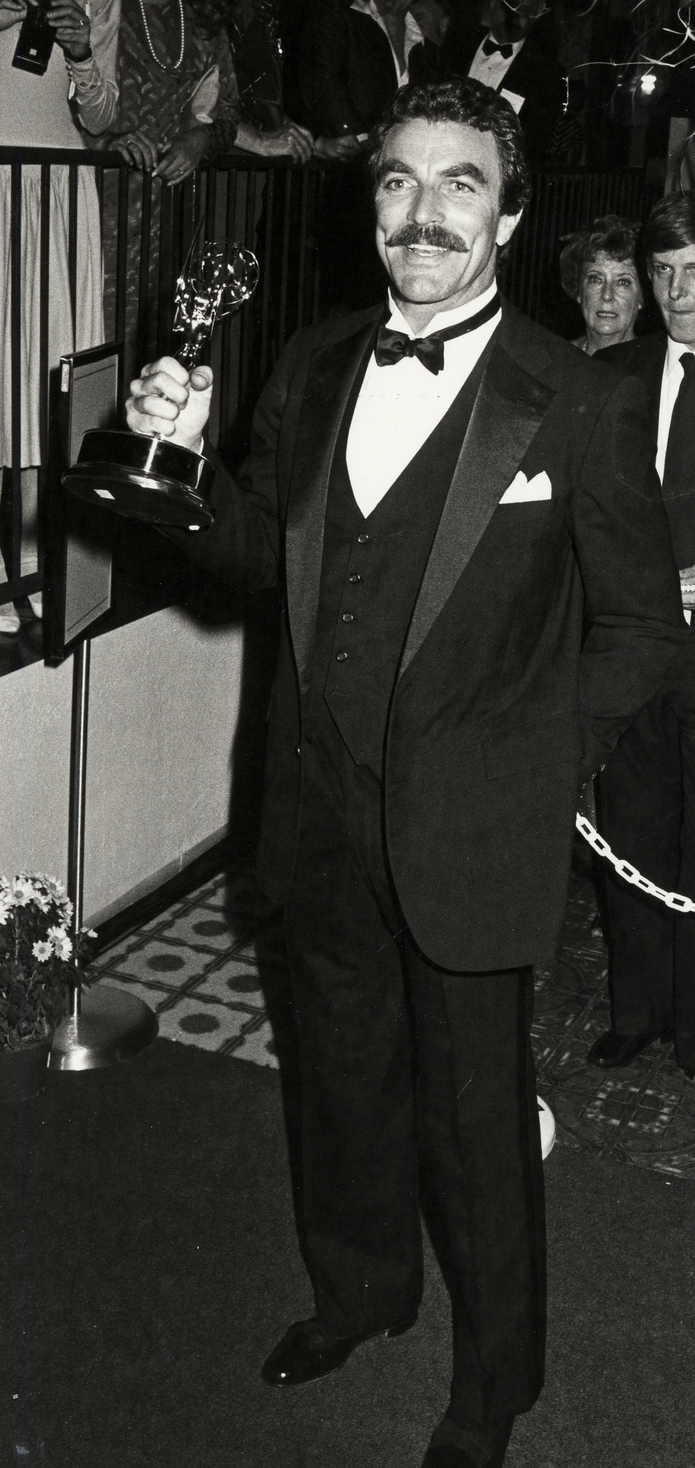 Tom Selleck at the 36th Annual Emmy Awards with his winning trophy.