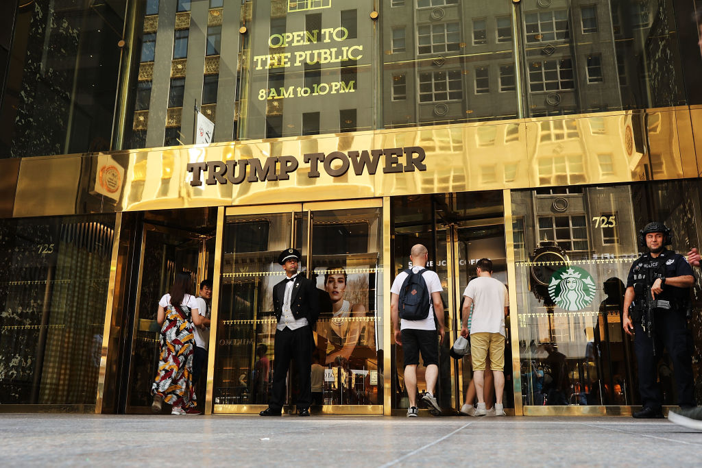 People walk by Trump Tower on Fifth Avenue in Manhattan on August 24, 2018 in New York.