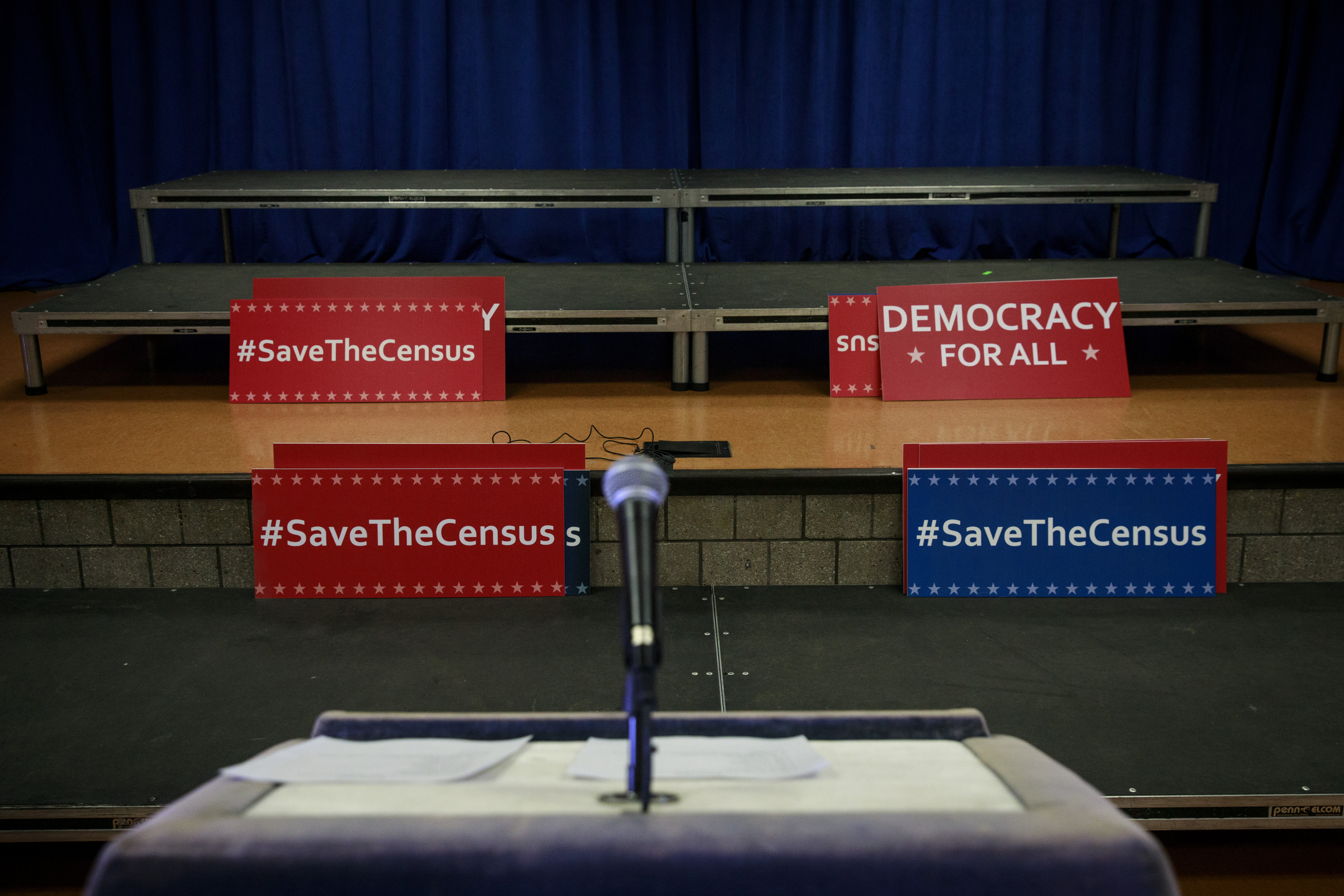 igns sit behind the podium before the start of a press conference with New York Attorney General Eric Schneiderman to announce a multi-state lawsuit to block the Trump administration from adding a question about citizenship to the 2020 Census form, at the headquarters of District Council 37, New York City's largest public employee union, April 3, 2018 in New York City.