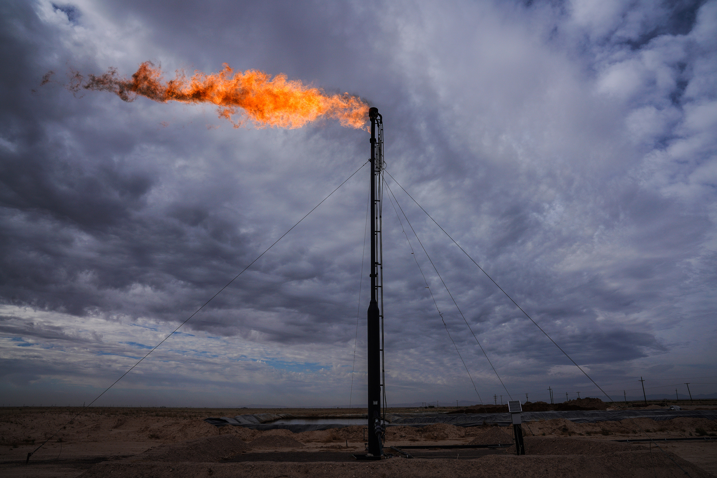 A gas flare shown here in May 2018 burns off excess gas in Midland, Texas, part of the Permian Basin, where an oil boom has remade the landscape.