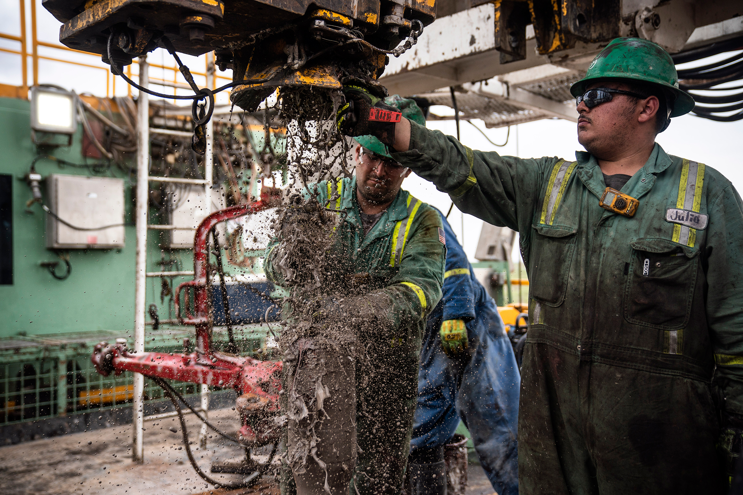 Oil workers, known as roughnecks, extracting oil at a Midland rig in May 2018; many laborers earn six-figure salaries because of high demand