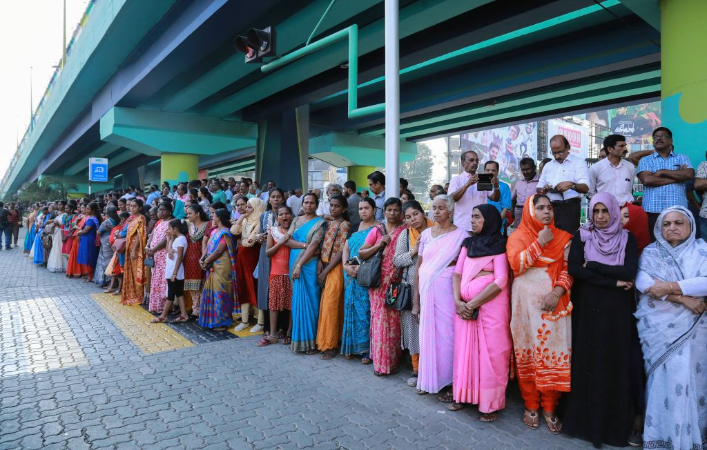 Indian women stand in a line to take part in a  women's wall  protest in Kochi in southern Kerala state on Jan. 1, 2019.