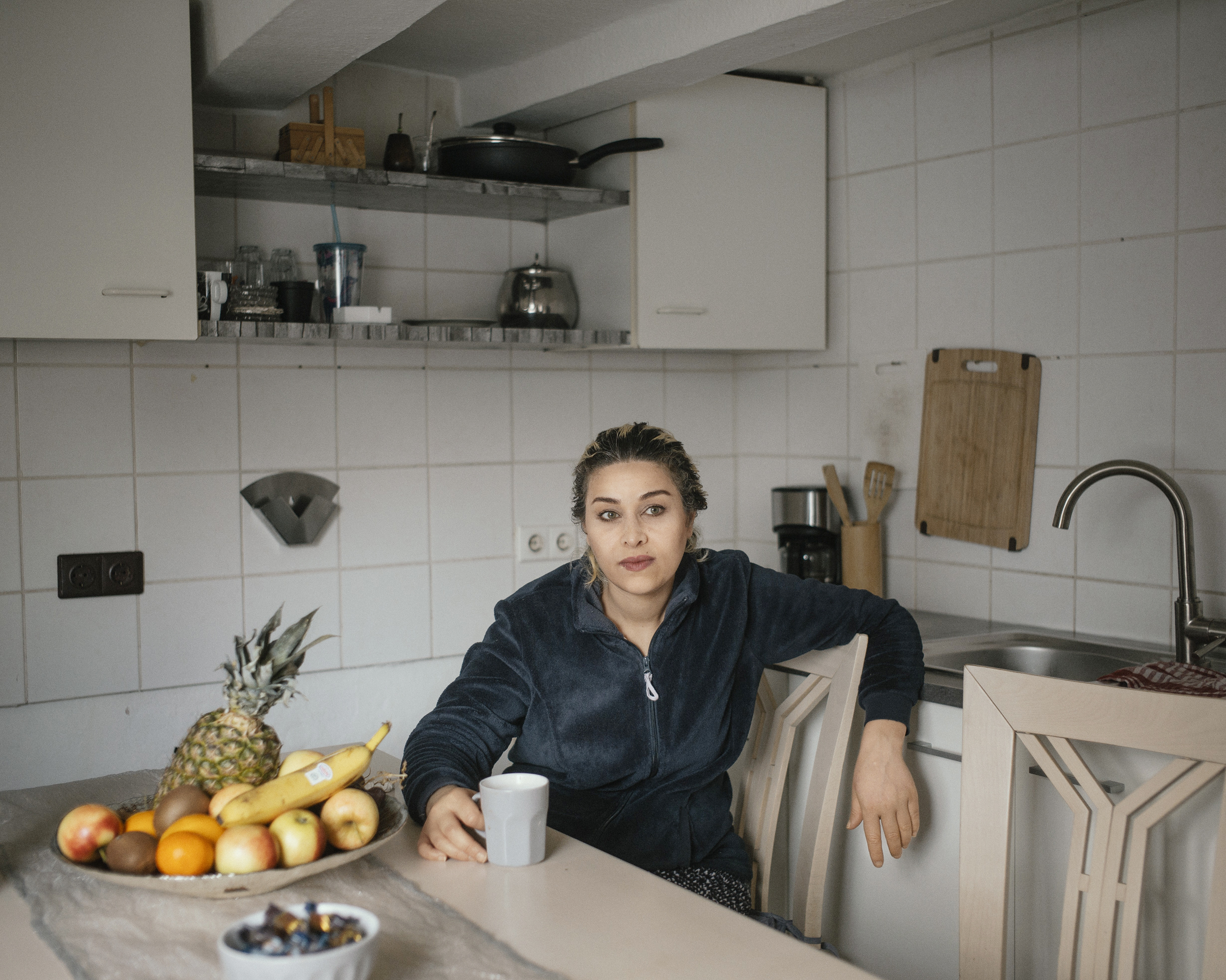 Oula Shaoud, a 35-year-old single mother of four children, in her kitchen in Anröchte, Germany.
