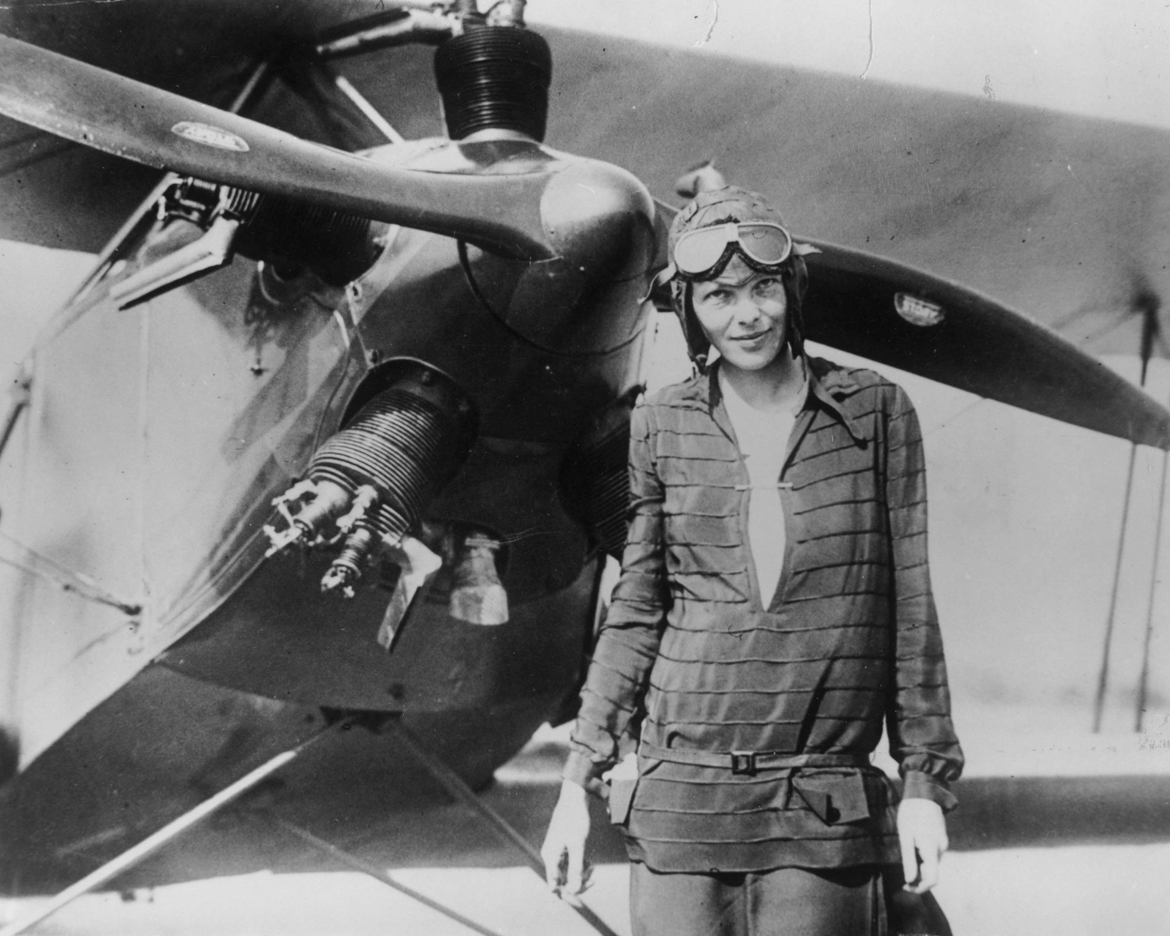 A June 1928 photo of Amelia Earhart in front of the bi-plane called 'Friendship' in Newfoundland.
