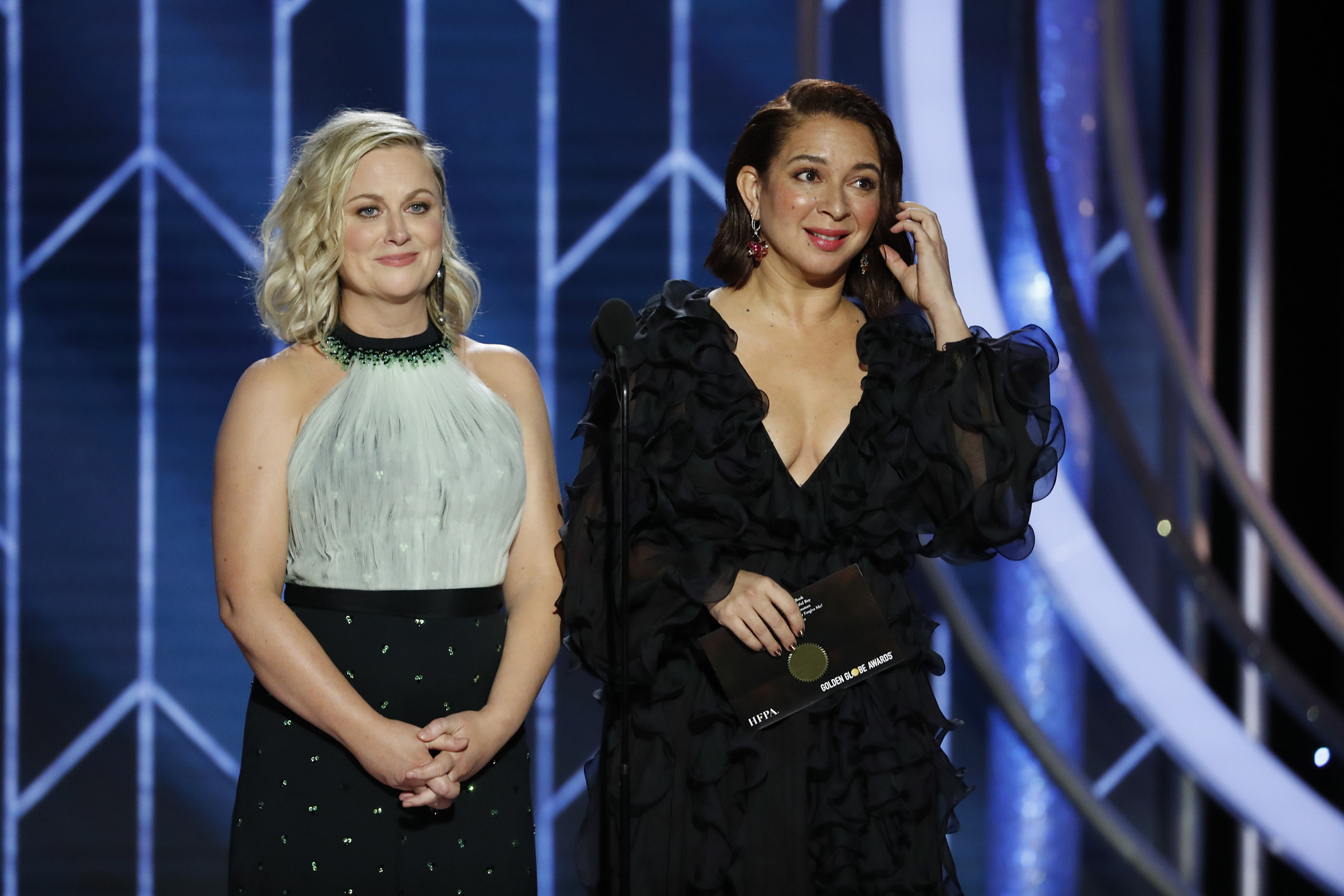 Presenters Amy Poehler and Maya Rudolph speak onstage during the 76th Annual Golden Globe Awards.