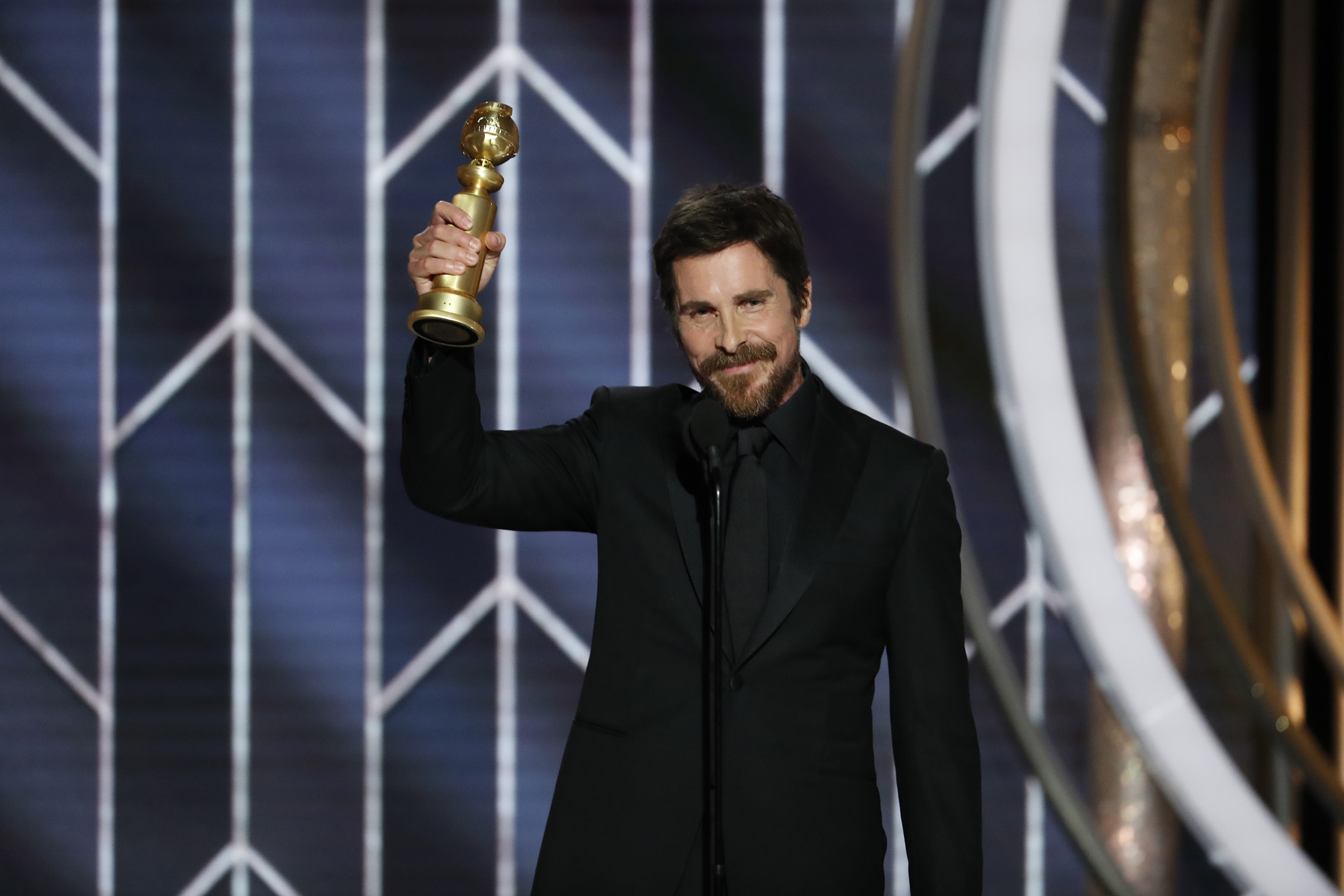 "Christian Bale from ""Vice"" accepts the Best Actor in a Motion Picture – Musical or Comedy award onstage during the 76th Annual Golden Globe Awards."