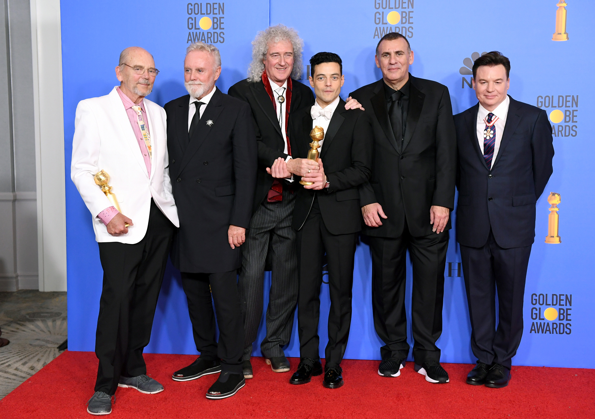 Jim Beach, Roger Taylor and Brian May of Queen, Best Actor in a Motion Picture Drama for 'Bohemian Rhapsody' winner Rami Malek, Producer Graham King, and Mike Myers pose in the press room during the 76th Annual Golden Globe Awards on Jan. 6, 2019 in Beverly Hills.
