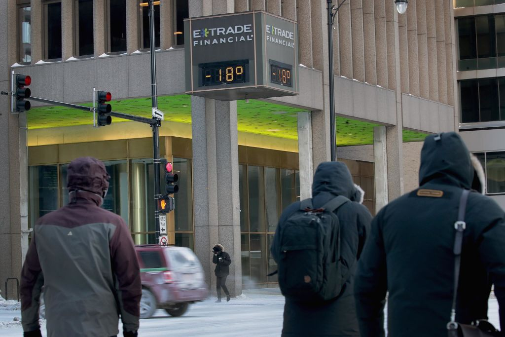 Commuters pass a thermometer registering -18 degrees downtown on Jan. 30, 2019 in Chicago, Illinois. It was reported that a pre-medical student at the University of Iowa died due to the extreme cold.