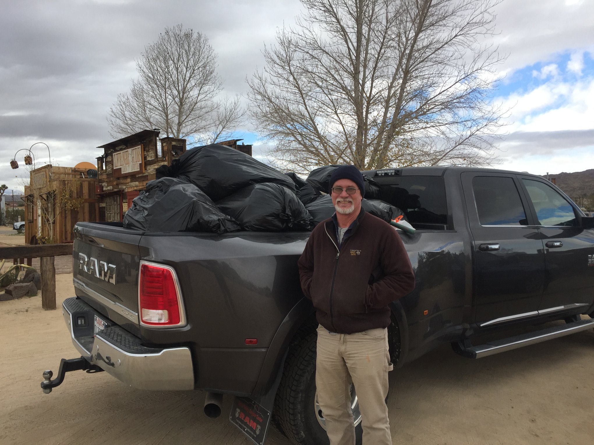 Seth Zaharias, co-owner of Cliffhanger Guides, helps haul  trash out of Joshua Tree National Park on Jan. 1, 2019.