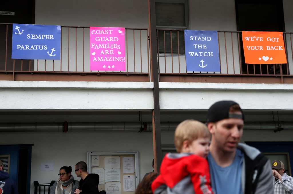 NOVATO, CALIFORNIA - JANUARY 19: Signs are posted during an event for U.S. Coast Guard families to receive free groceries on January 19, 2019 in Novato, California. As the partial government shutdown enters its fourth week, an estimated 150 U.S. Coast Guard families in the San Francisco Bay Area, who are currently not being paid, received free groceries during an event organized by the San Francisco-Marin Food Bank and the North Bay Coast Guard Spouses Club. (Photo by Justin Sullivan/Getty Images)