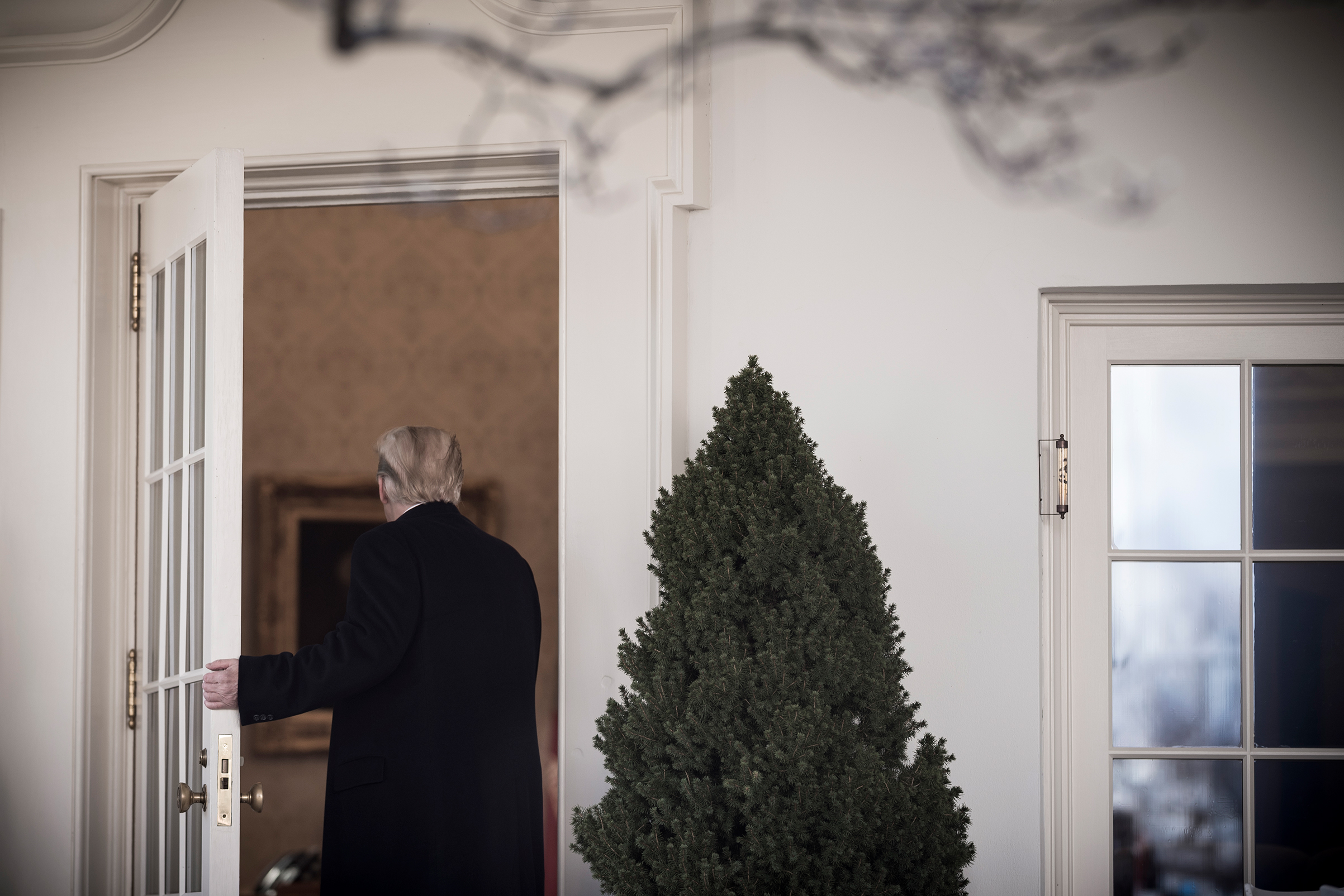 President Trump returns to the Oval Office after his remarks on the shutdown on Jan. 25, 2019.