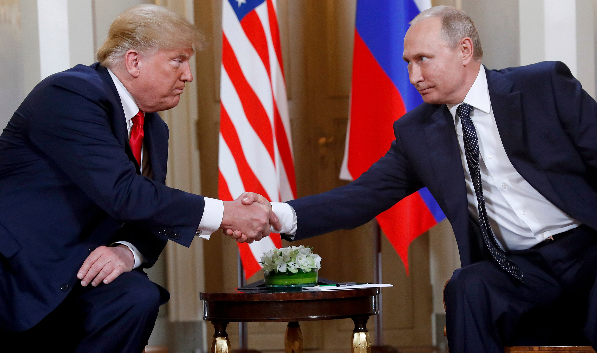 President Donald Trump and Russian President Vladimir Putin shake hands at the beginning of a meeting in Helsinki on July 15, 2018.