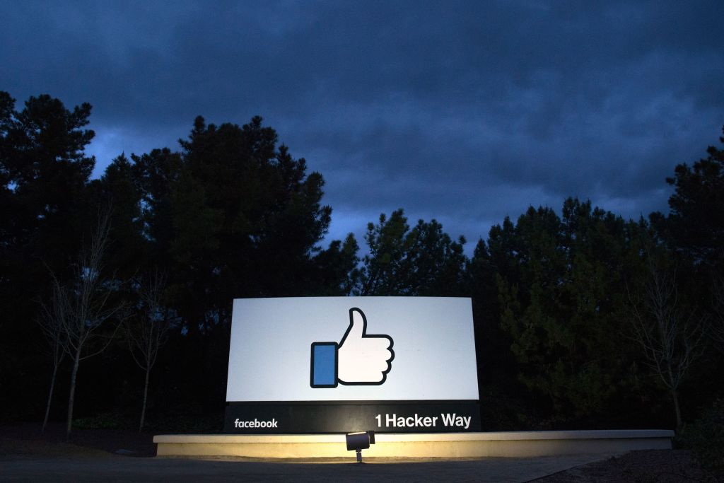 A lit sign is seen at the entrance to Facebook's corporate headquarters location in Menlo Park, Ca. on March 21, 2018. Facebook said on Jan. 31, 2019 that it has removed 783 fake accounts linked to Iran.
