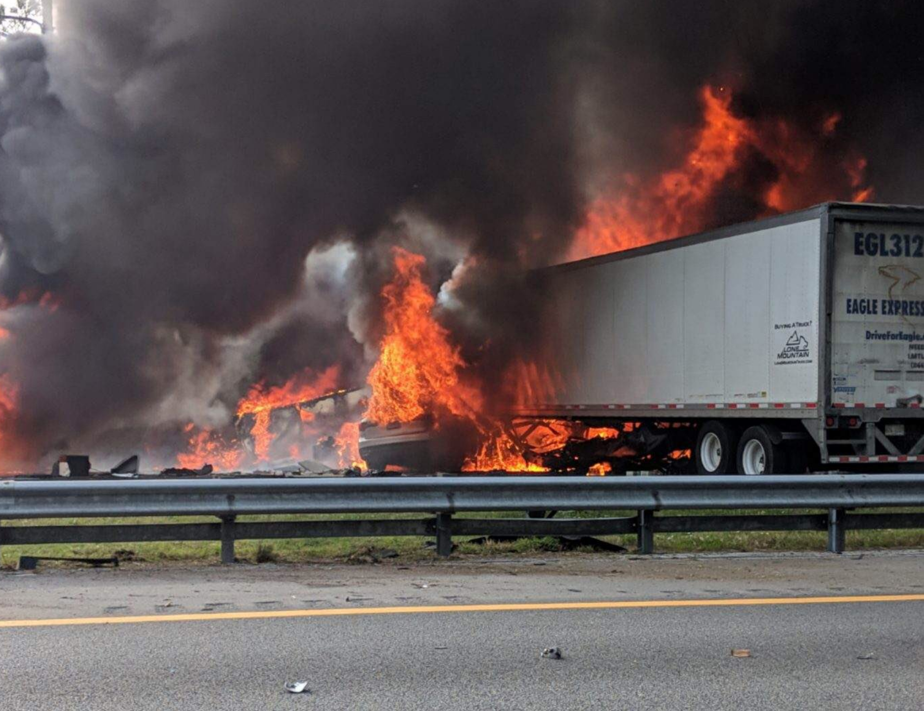 Flames engulf vehicles after a fiery crash along Interstate 75 on Thursday, Jan. 3, 2019, about a mile south of Alachua, near Gainesville, Fla. Highway officials say at least seven people have died after a crash and diesel fuel spill sparked a massive fire along the Florida interstate.