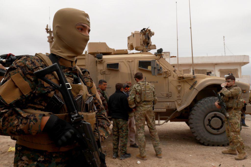 U.S. forces patrol the Kurdish-held town of Al-Darbasiyah in northeastern Syria bordering Turkey on Nov. 4, 2018