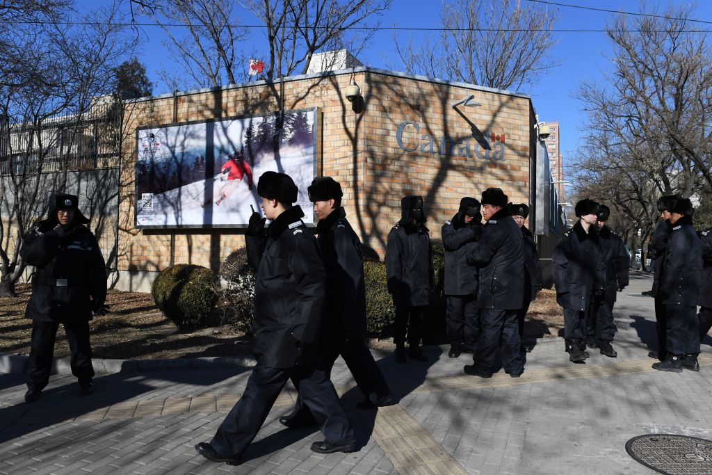 Chinese police patrol in front of the Canadian embassy in Beijing on Dec. 13, 2018.
