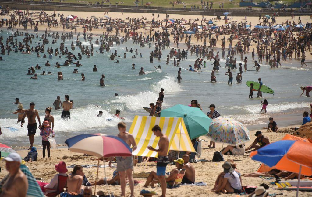 Sunbathers are seen on Bondi Beach as temperatures soar in Sydney on Dec. 28, 2018.