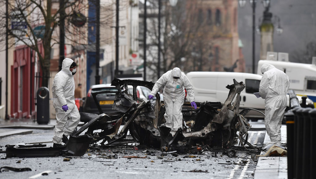 Forensic officers inspect the remains of a van used as a car bomb on an attack outside the Derry Court House in Londonderry, Northern Ireland on Jan. 20, 2019.