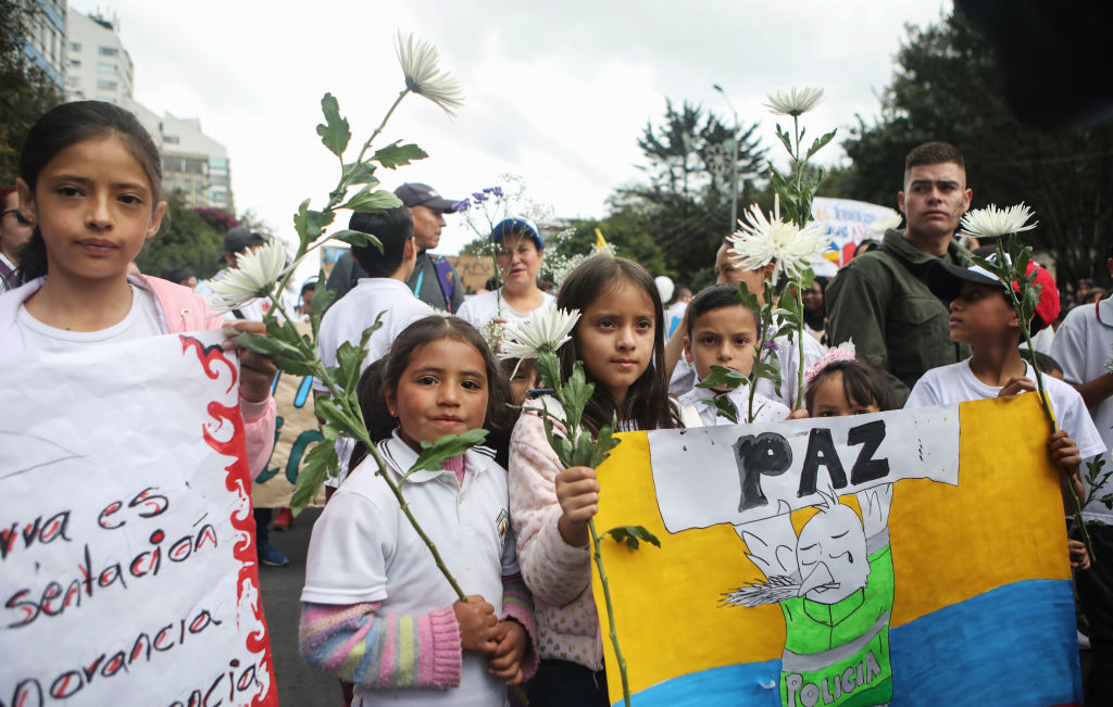 Children take part in a march against terrorism in Bogota on Jan. 20, 2019.