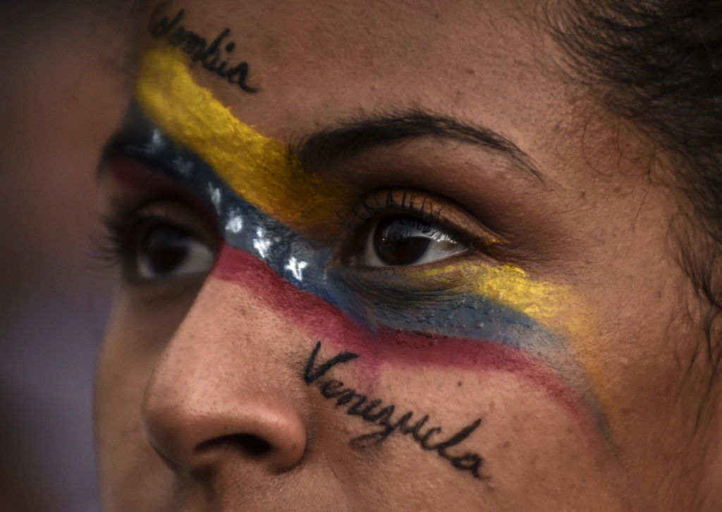 Venezuelans opposed to President Nicolas Maduro hold a demonstration in Medellin, Colombia in support of opposition leader Juan Guaido's self-proclamation as acting president of Venezuela, on Jan. 23, 2019.