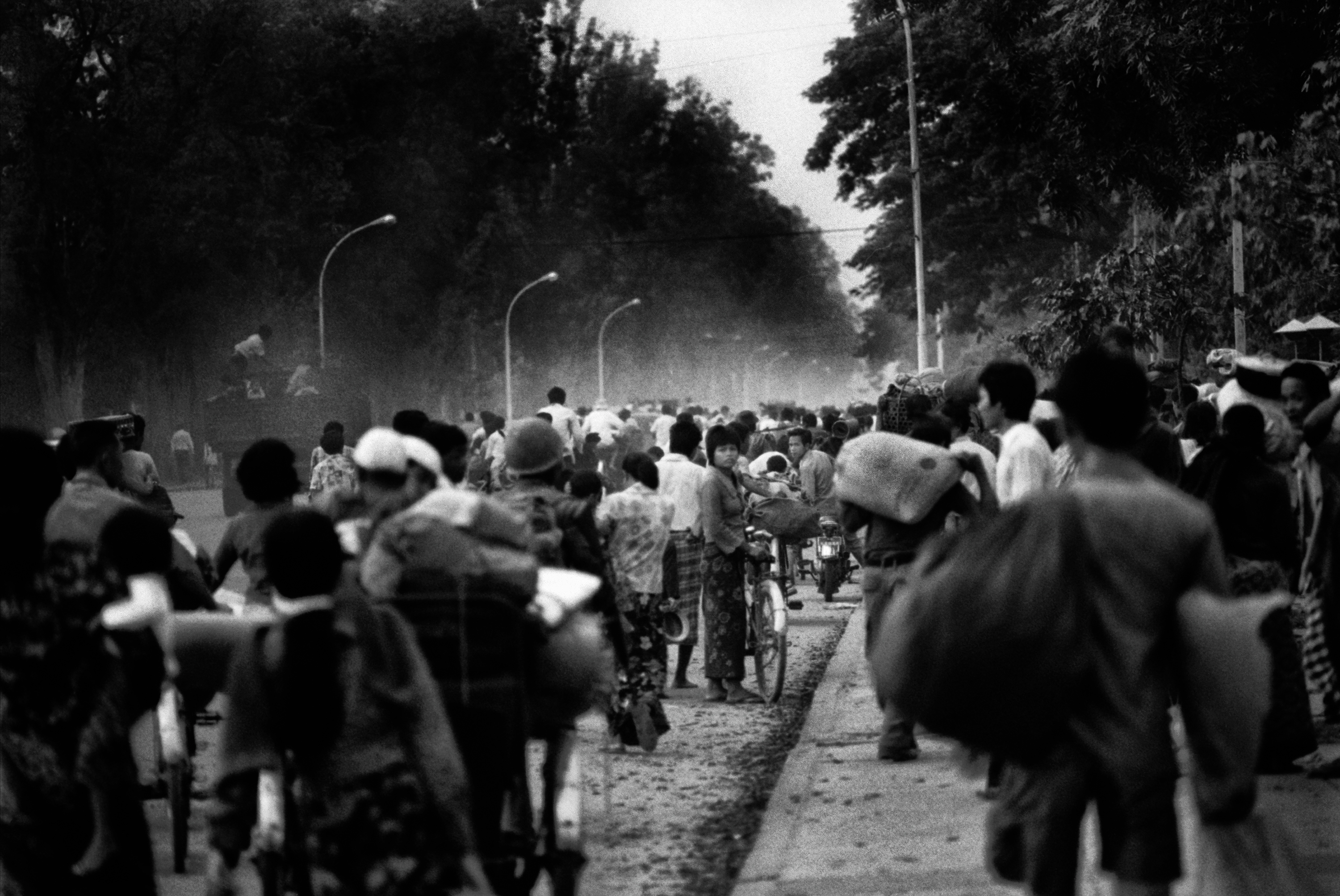 On the eve of the Fall of Phnom Penh to the Khmer Rouge on April 16, 1975 as night fell, thousands of people streamed towards the center of Phnom Penh on Monivong Boulevard.