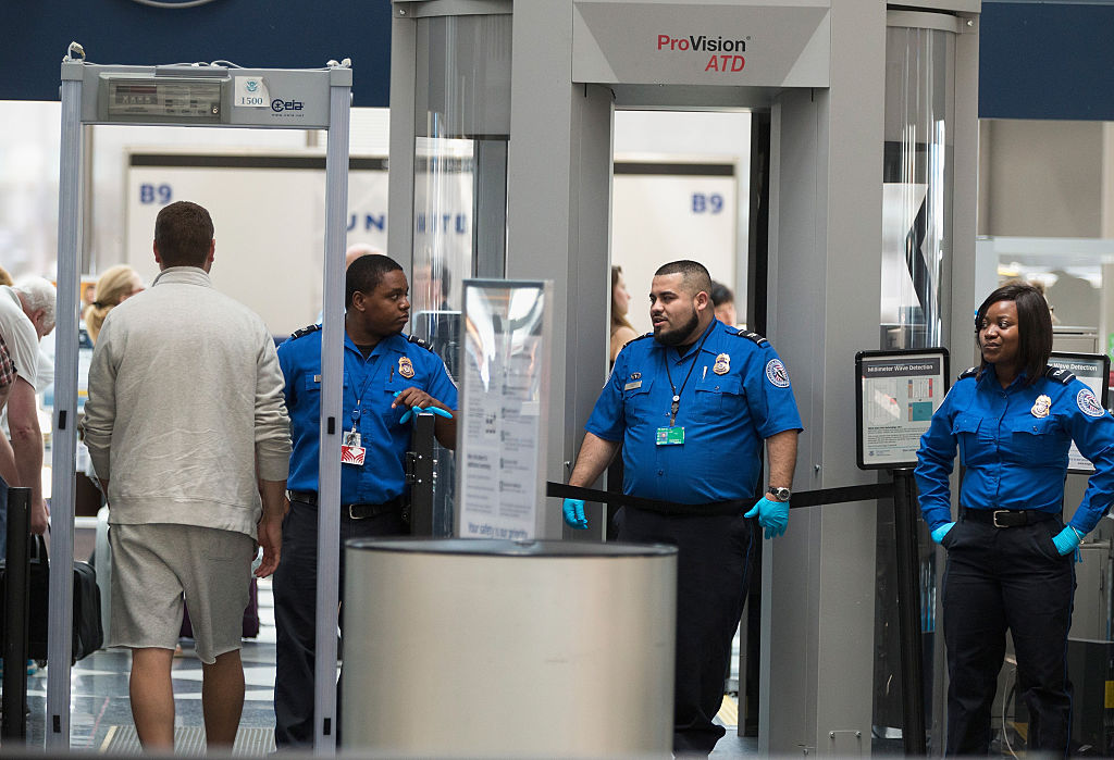 JUNE 02:  Travelers are screened by Transportation Security Administration (TSA) workers