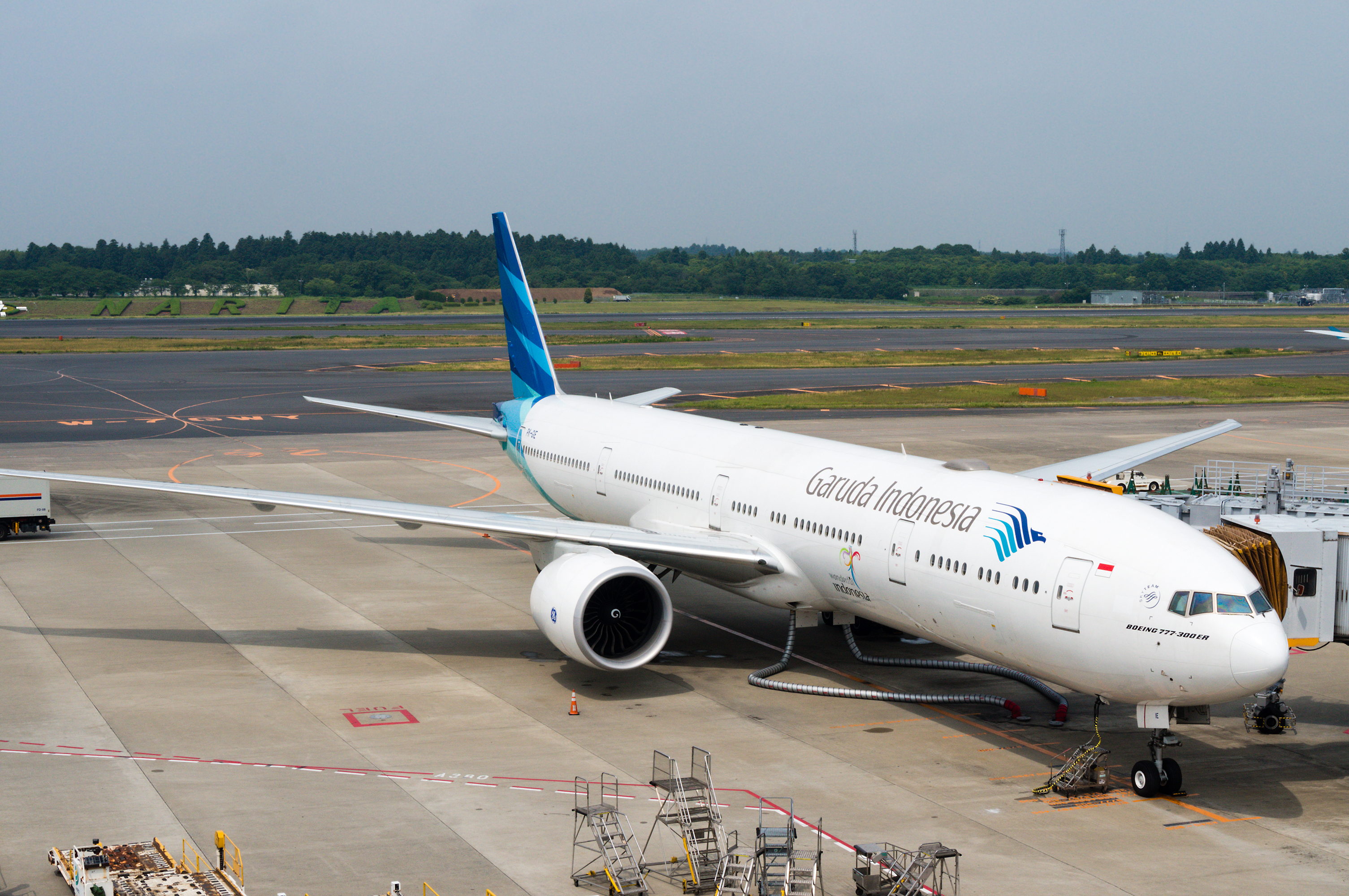 A Garuda Indonesia plane being serviced on the tarmac of Tokyo Narita Airport on June 15, 2015.