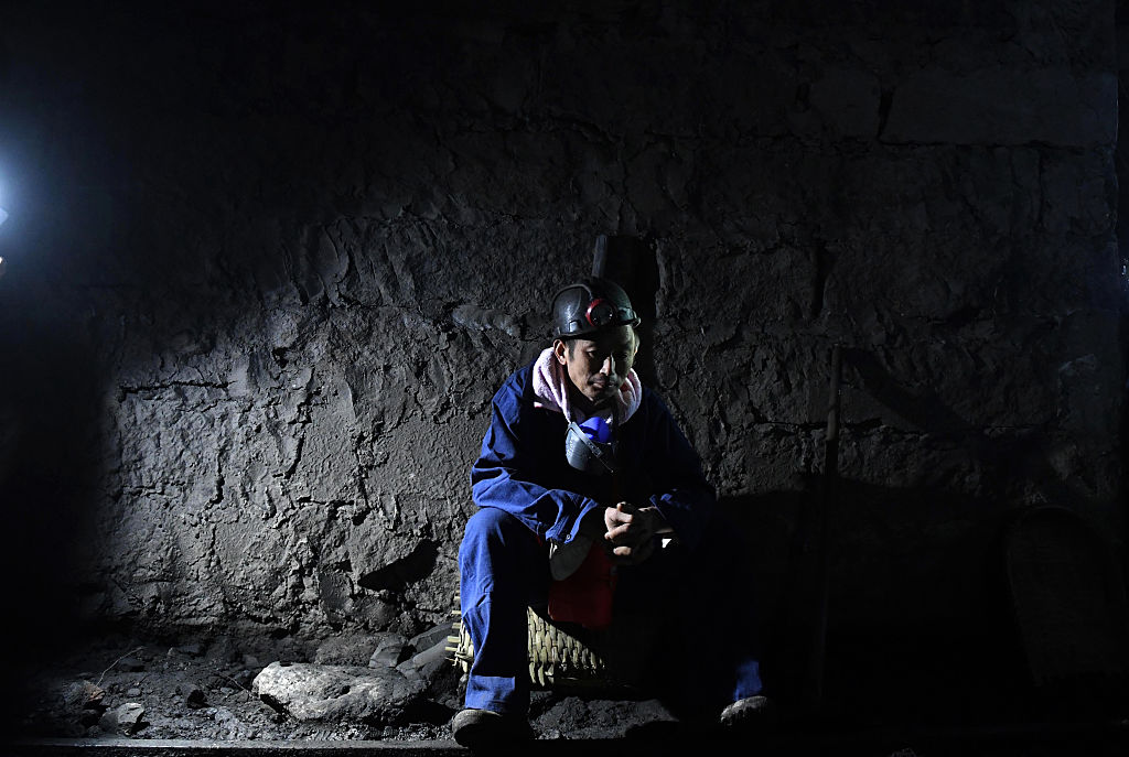 A rescuer waiting at the pithead of Jinshangou coal mine, where 33 miners were killed after a colliery explosion, in Yongchuan district of Chongqing, China on Oct. 31, 2016.